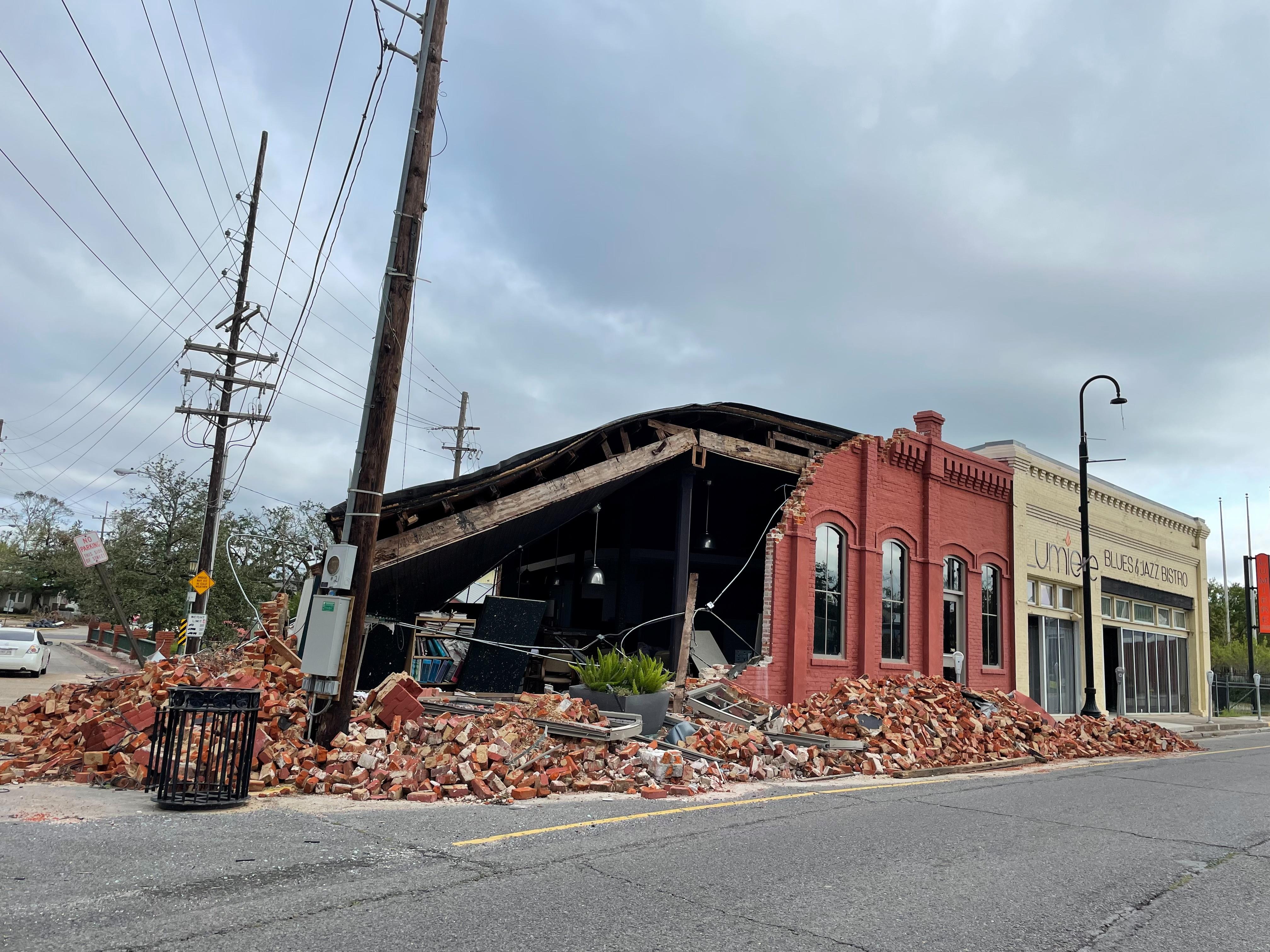 A damaged building is seen in downtown Houma following Hurricane Ida, Louisiana, U.S., September 22, 2021. Picture taken September 22, 2021. REUTERS/Liz Hampton