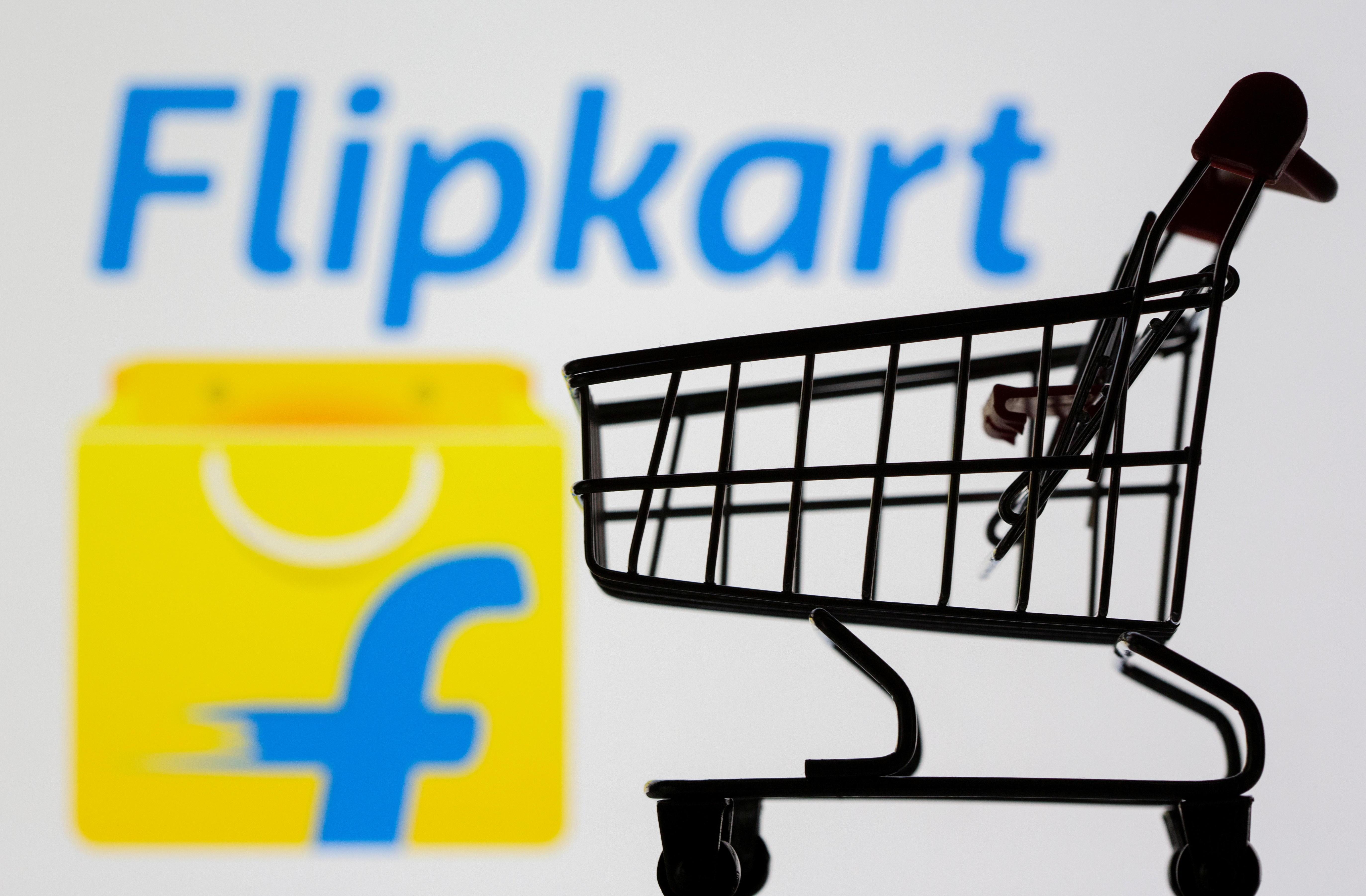 Small toy shopping cart is seen in front of displayed Flipkart logo in this illustration taken, July 30, 2021. REUTERS/Dado Ruvic/Illustration