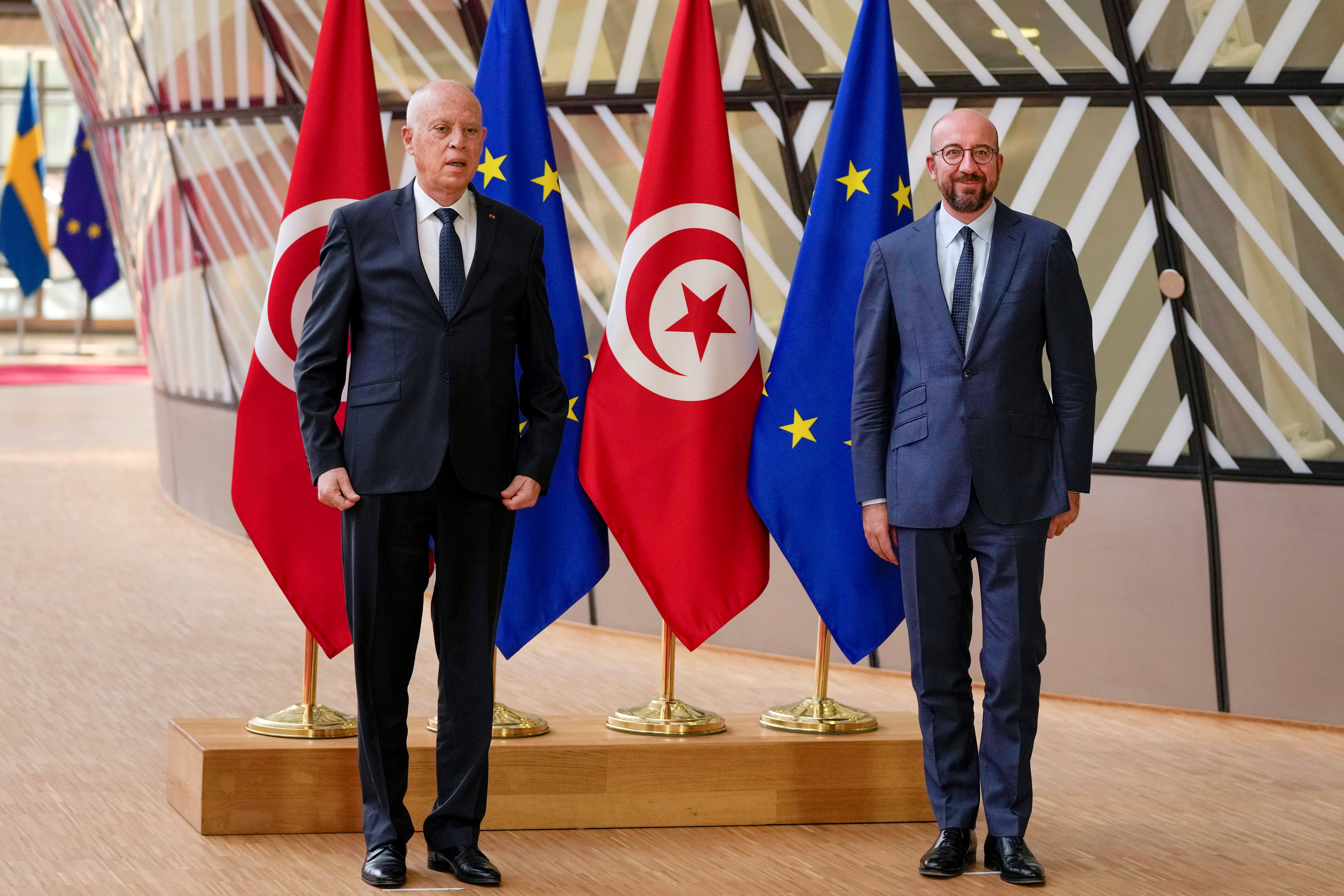 Tunisian President Kais Saied and European Council President Charles Michel pose for the media prior their meeting at the European Council headquarters in Brussels, Belgium June 4, 2021. Francisco Seco/Pool via REUTERS/File Photo