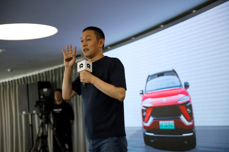 William Li, founder and chief executive officer (CEO) of the electric vehicle maker NIO Inc, speaks at a launch event on battery leasing service in Beijing, China August 20, 2020. REUTERS/Tingshu Wang