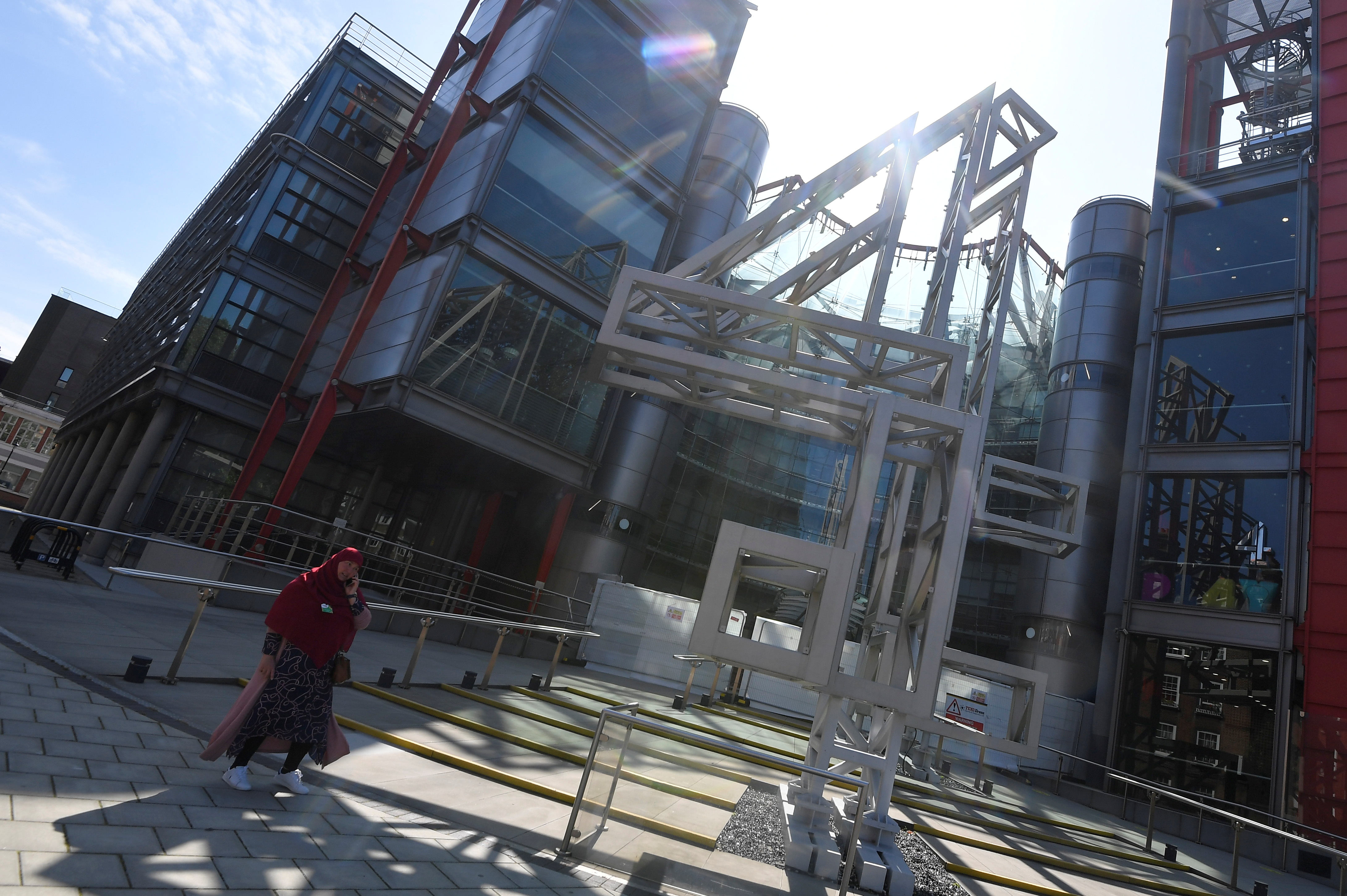 A person walks past the Channel 4 television channel offices in London, Britain, June 23, 2021. REUTERS/Toby Melville