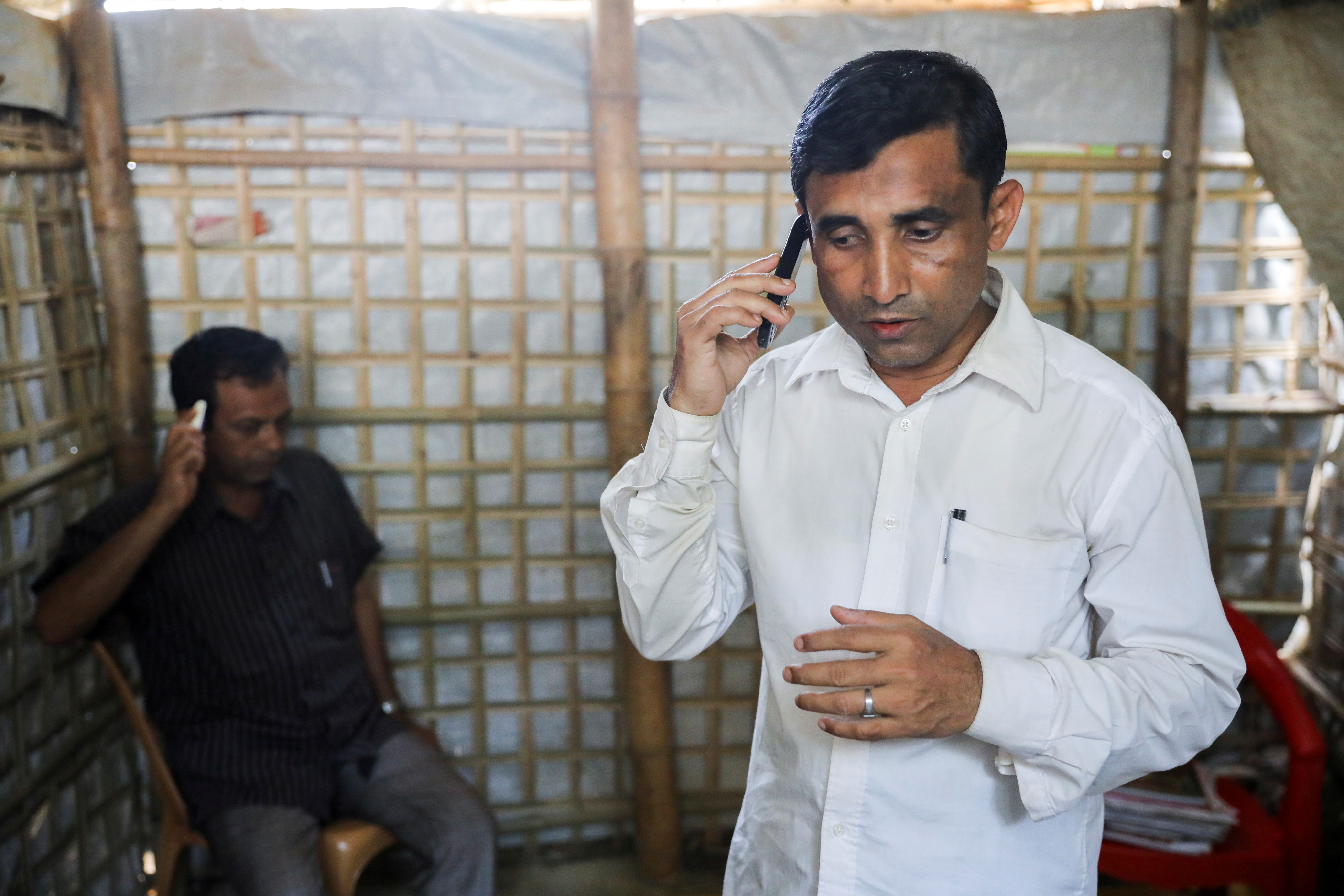 Mohib Ullah, a Rohingya Muslim leader from the Arakan Rohingya Society for Peace and Human Rights, speaks on a phone at his residence in Kutupalong refugee camp in Ukhiya, Cox's Bazar, Bangladesh, April 21, 2018. Picture taken April 21, 2018. REUTERS/Mohammad Ponir Hossain/File Photo