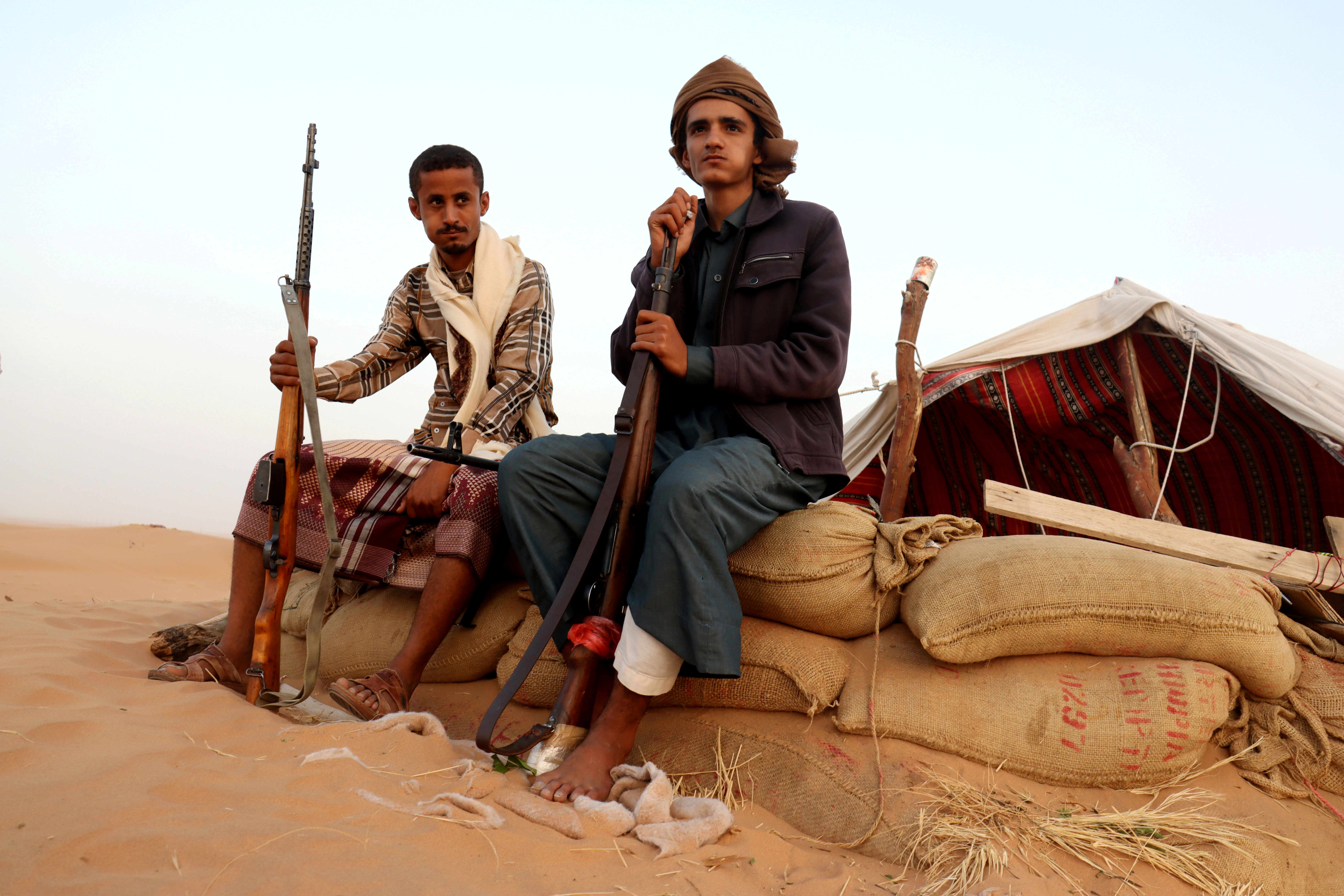 Armed men loyal to the government forces guard a site near the Safer oil fields in Marib, Yemen September 12, 2021. Picture taken September 12, 2021. REUTERS/Ali Owidha/File Photo