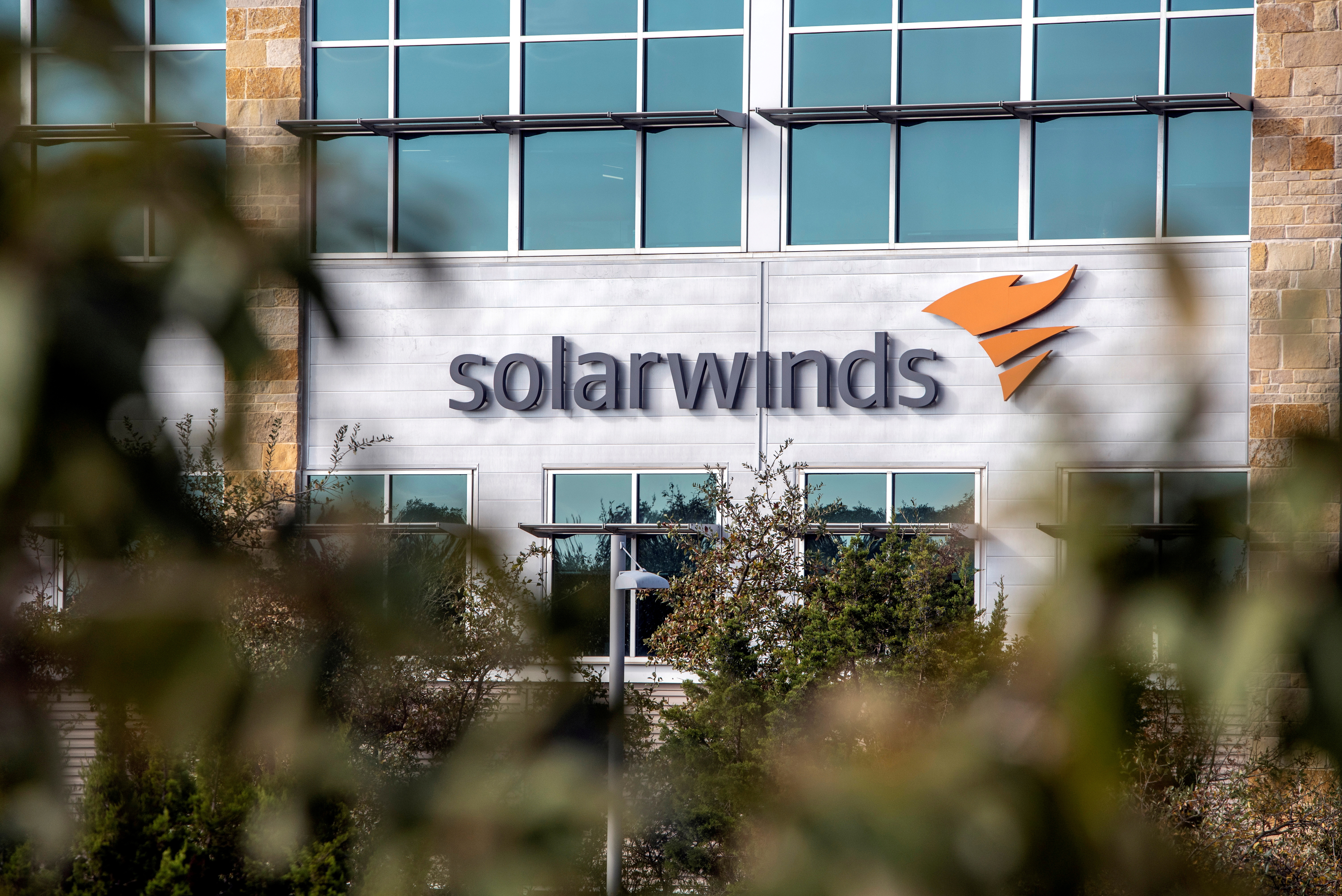 The SolarWinds logo is seen outside its headquarters in Austin, Texas, U.S., December 18, 2020. REUTERS/Sergio Flores/File Photo/File Photo