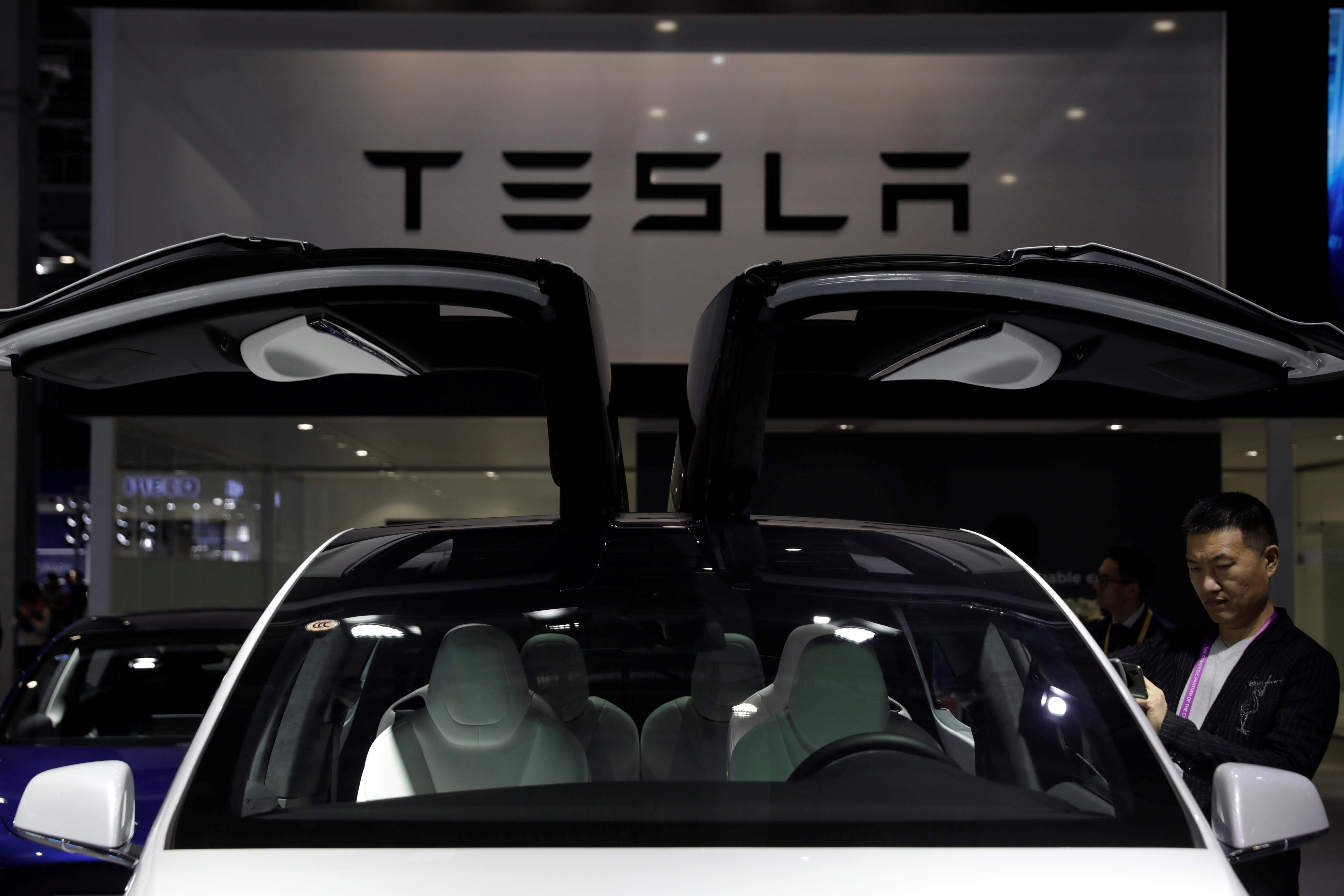 A Tesla sign is seen at the second China International Import Expo (CIIE) in Shanghai, China November 5, 2019. REUTERS/Aly Song/Files