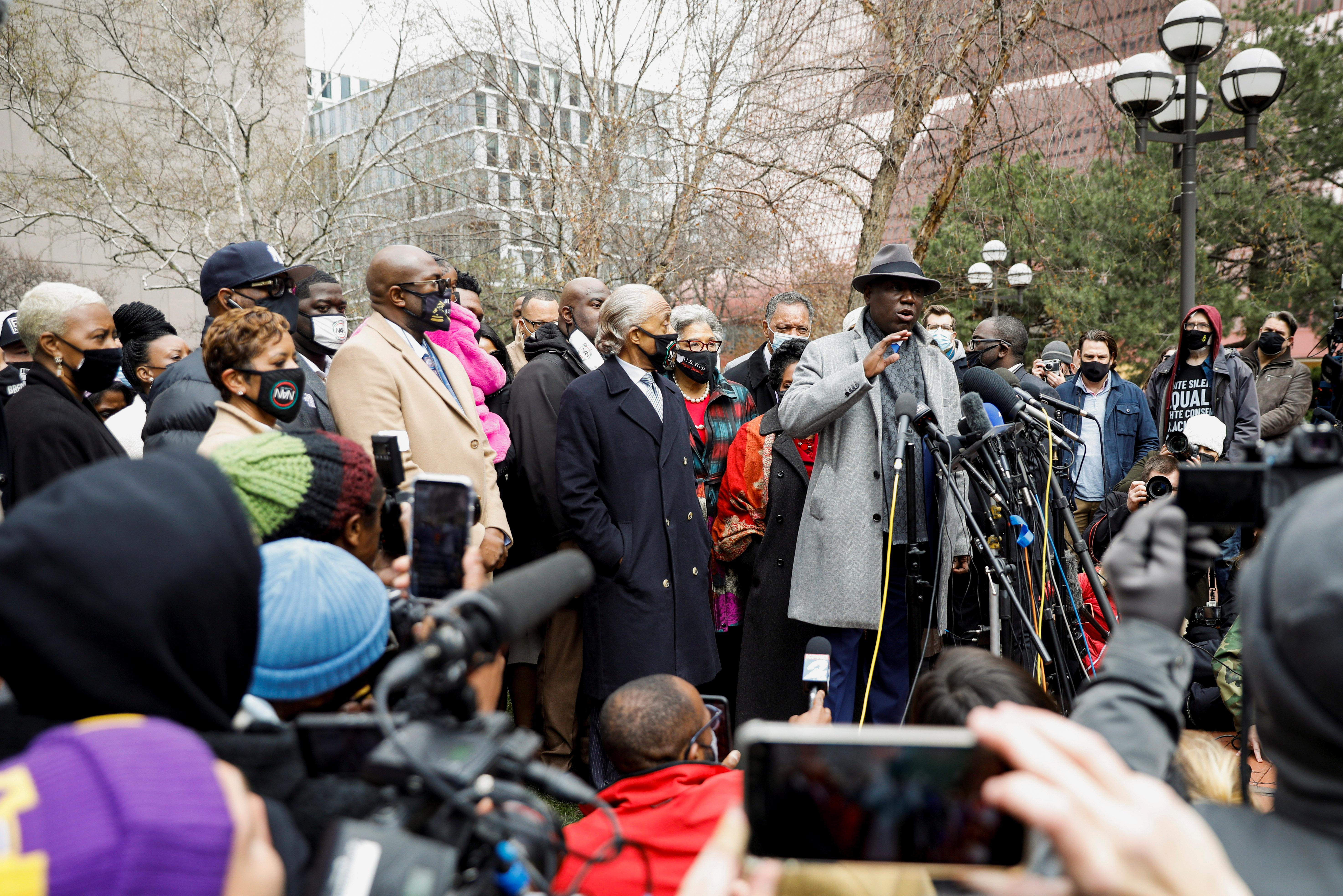 Floyd family attorney Ben Crump addresses the media during a press conference with family members of George Floyd, Reverend Al Sharpton, Rev Jesse Jackson and US Congressperson Ilhan Omar at a press conference outside the Hennepin County Government Center during the closing statements in the trial of former police officer Derek Chauvin, who is facing murder charges in the death of George Floyd, in Minneapolis, Minnesota, U.S., April 19, 2021. REUTERS/Nicholas Pfosi