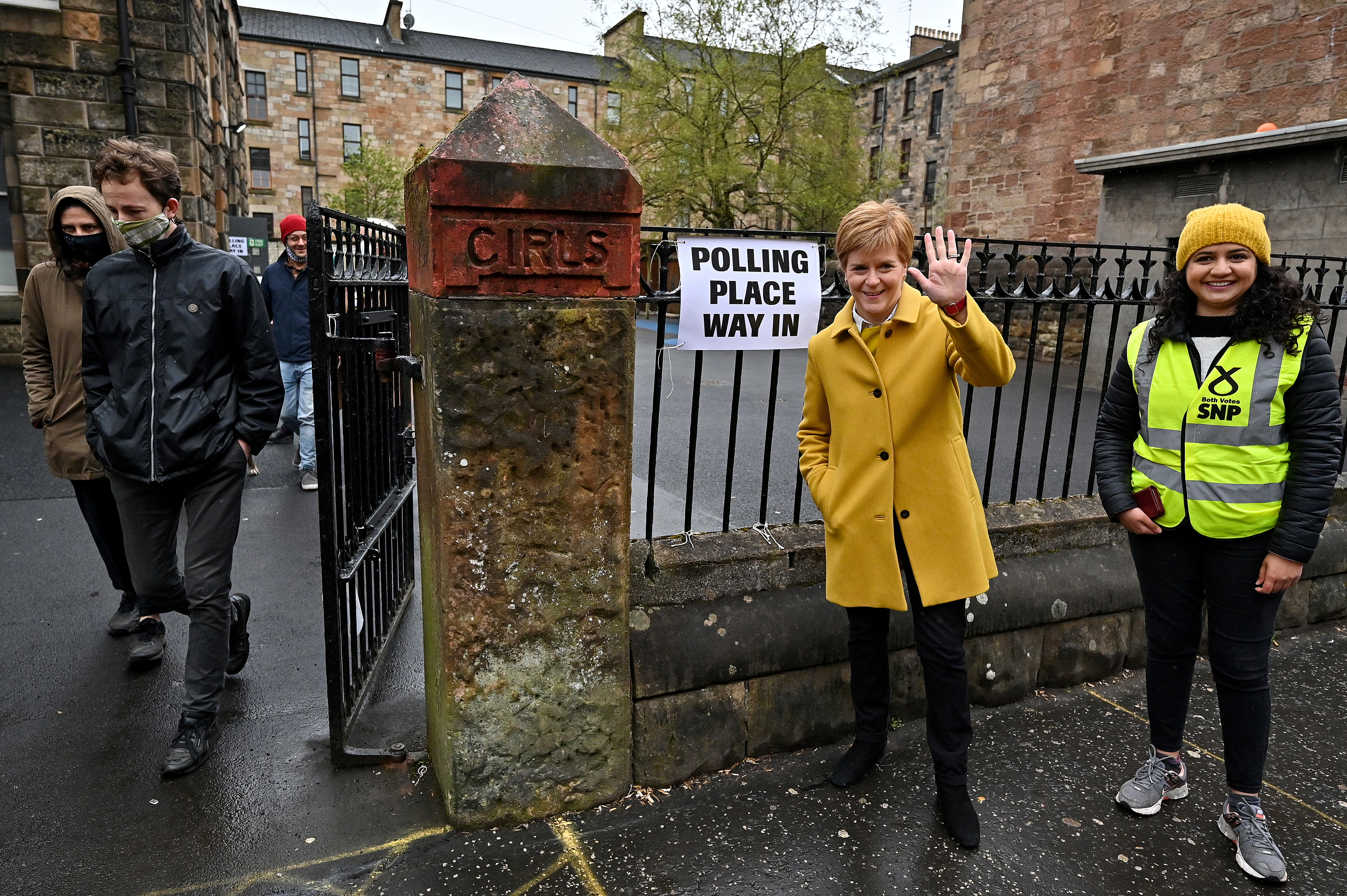 Scotland's First Minister Nicola Sturgeon and candidate Roza Salih meet voters at Annette Street School polling station as Scotland's parliamentary election voting has begun, in Glasgow, Britain, May 6, 2021 . Jeff J Mitchell/Pool via REUTERS