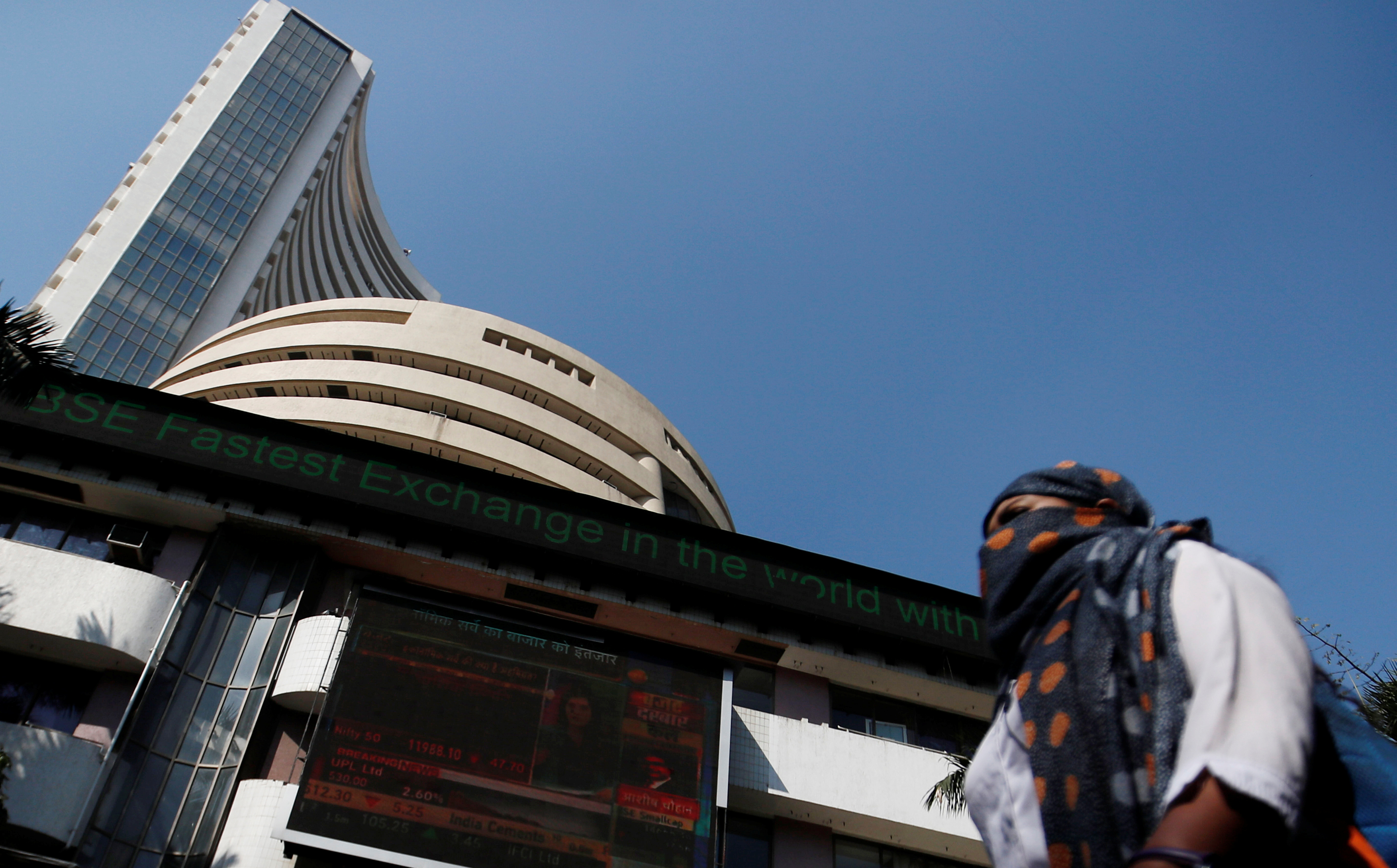 A woman walks past the Bombay Stock Exchange (BSE) building in Mumbai, India, January 31, 2020. REUTERS/Francis Mascarenhas/File Photo