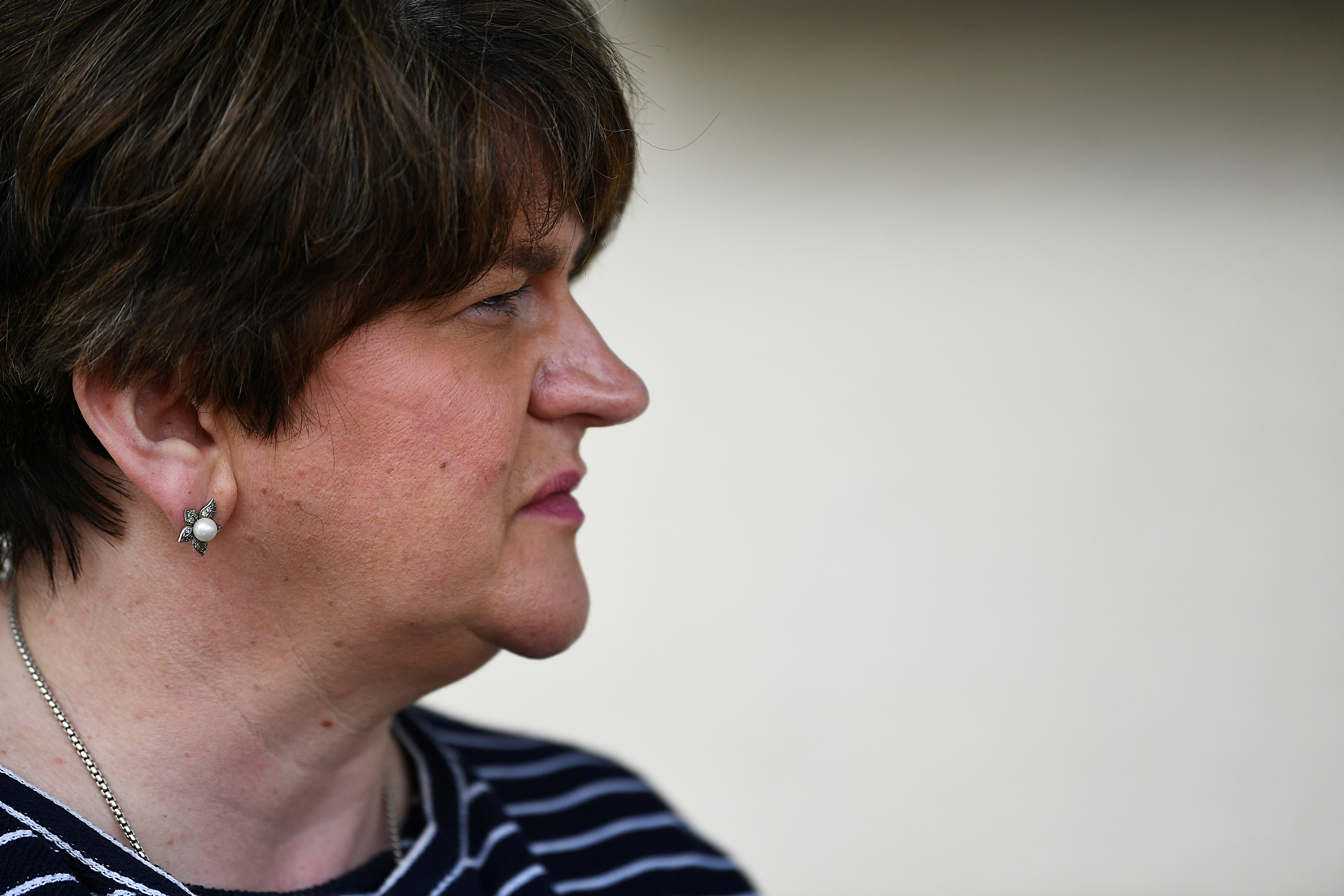 Northern Ireland's First Minister Arlene Foster looks on outside the Strand Cinema, as coronavirus disease (COVID-19) restrictions begin to ease in Belfast, Northern Ireland, May 24, 2021. REUTERS/Clodagh Kilcoyne/File Photo
