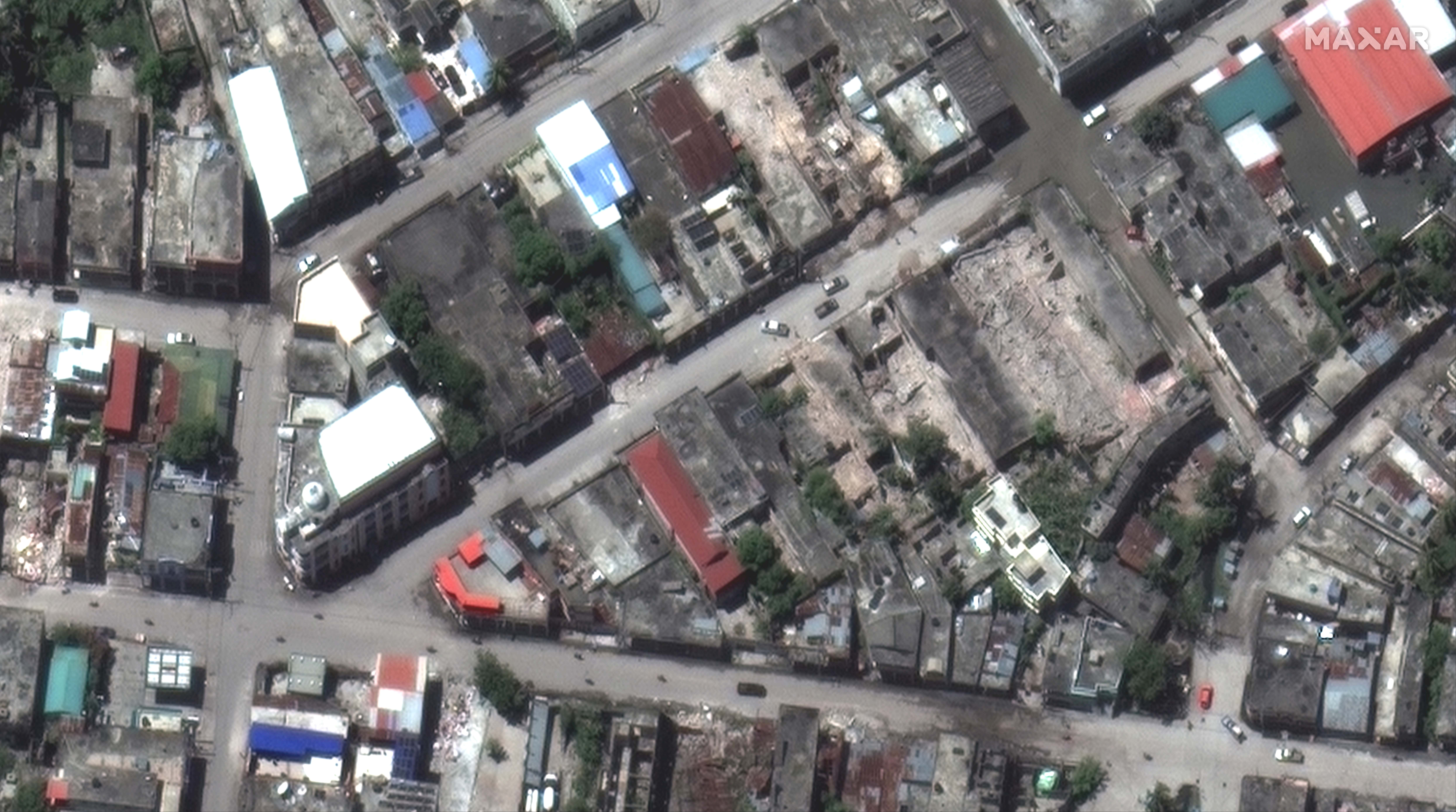 A satellite image shows collapsed buildings in Les Cayes, after a 7.2 magnitude earthquake struck Haiti, August 15, 2021. SATELLITE IMAGE 2021 MAXAR TECHNOLOGIES/Handout via REUTERS