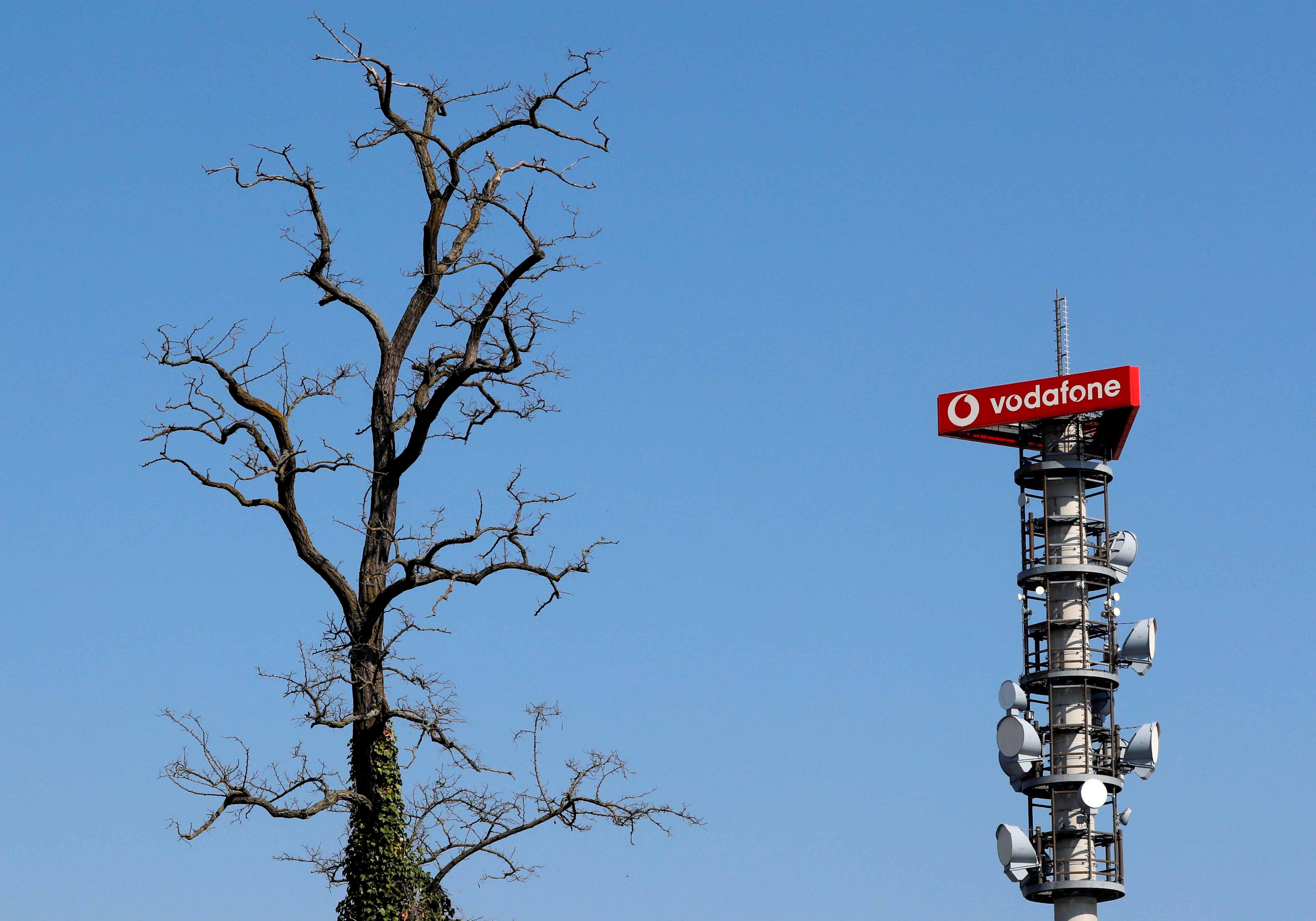 Different types of 4G, 5G and data radio relay antennas for mobile phone networks are pictured on a relay mast operated by Vodafone in Berlin, Germany April 8, 2019.  REUTERS/Fabrizio Bensch