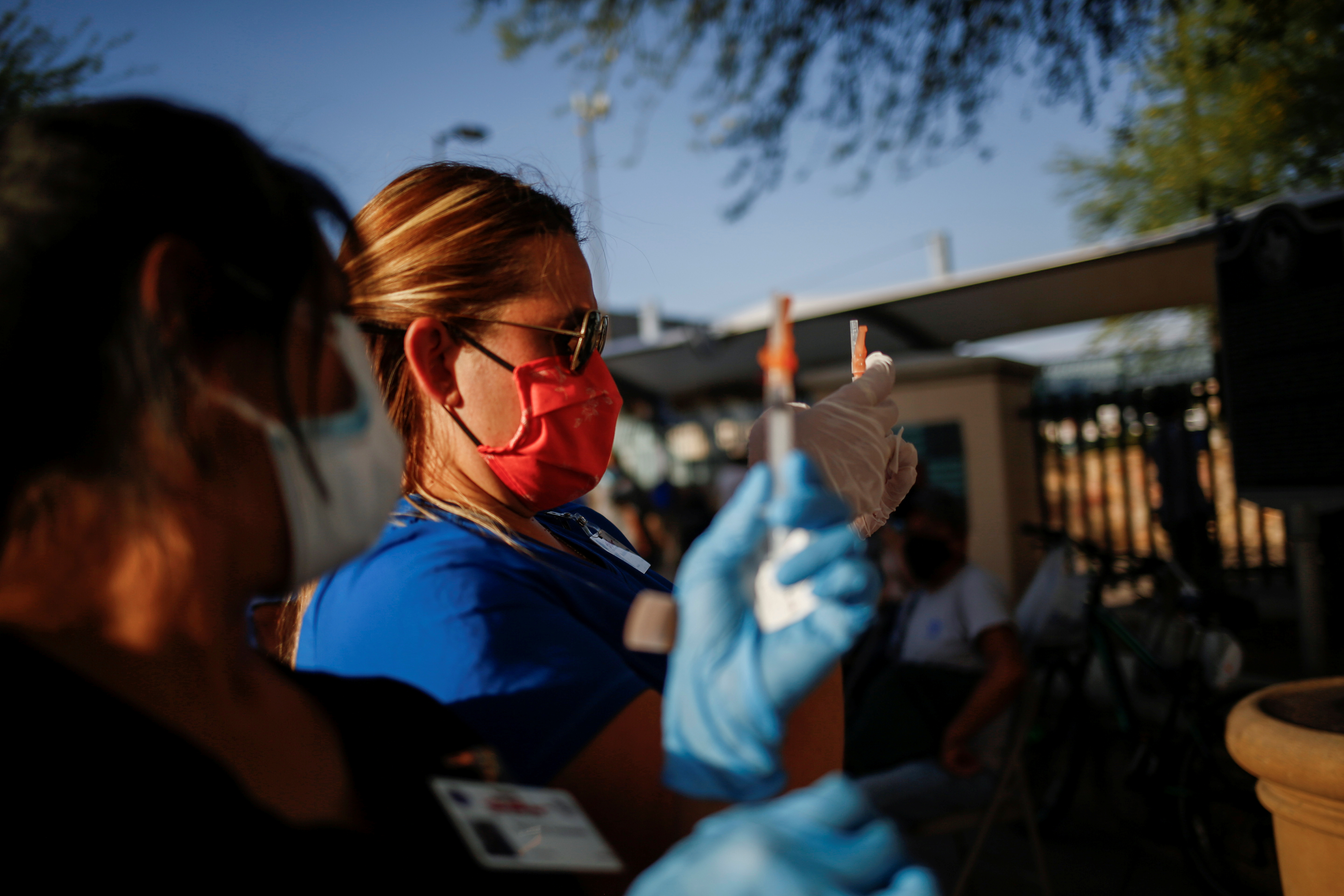 Healthcare workers from the El Paso Fire Department prepare Moderna vaccines against the coronavirus disease (COVID-19) at a vaccination centre near the Santa Fe International Bridge, in El Paso, Texas, U.S May 7, 2021. Picture taken May 7, 2021.  REUTERS/Jose Luis Gonzalez