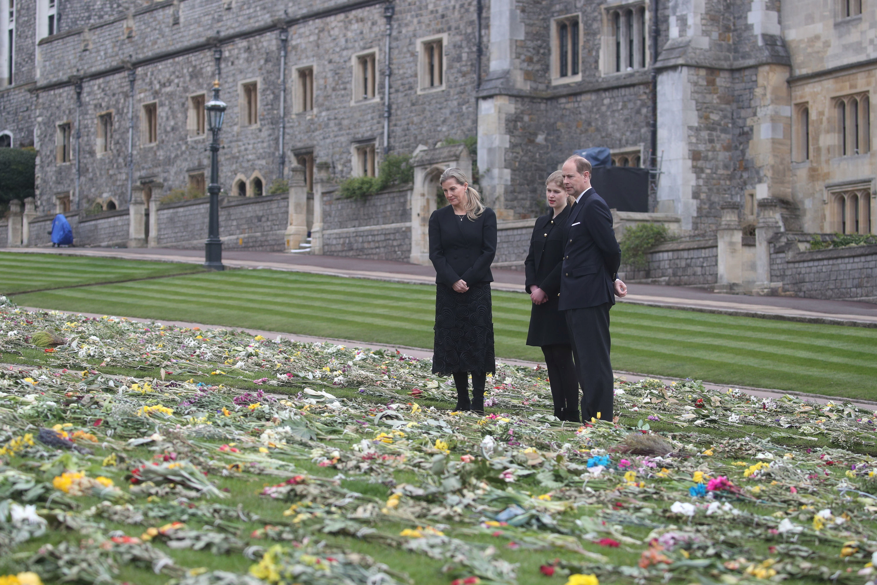 Britain's Sophie, the Countess of Wessex, Lady Louise Windsor, and Prince Edward, Earl of Wessex,   view flowers outside St George's Chapel, following the death of Britain's Prince Philip, the Duke of Edinburgh at the age of 99, at Windsor Castle, Berkshire, Britain April 16, 2021. Steve Parsons/PA Wire/Pool via REUTERS