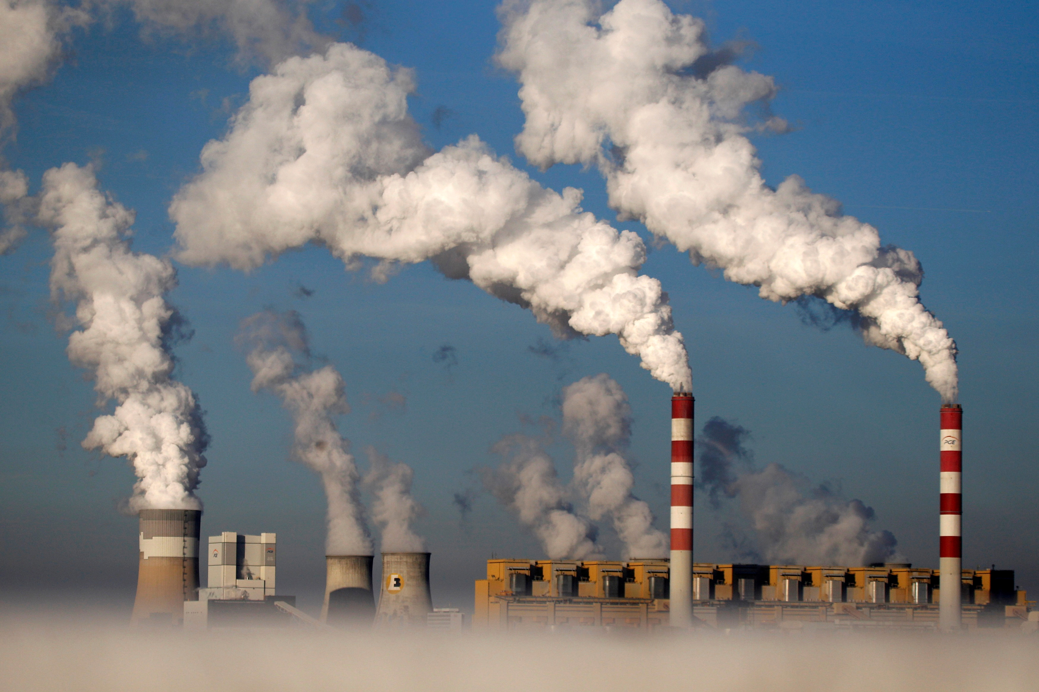 Smoke billows from the chimneys of the Belchatow power station in Belchatow, Poland, October 31, 2013. REUTERS/Kacper Pempel