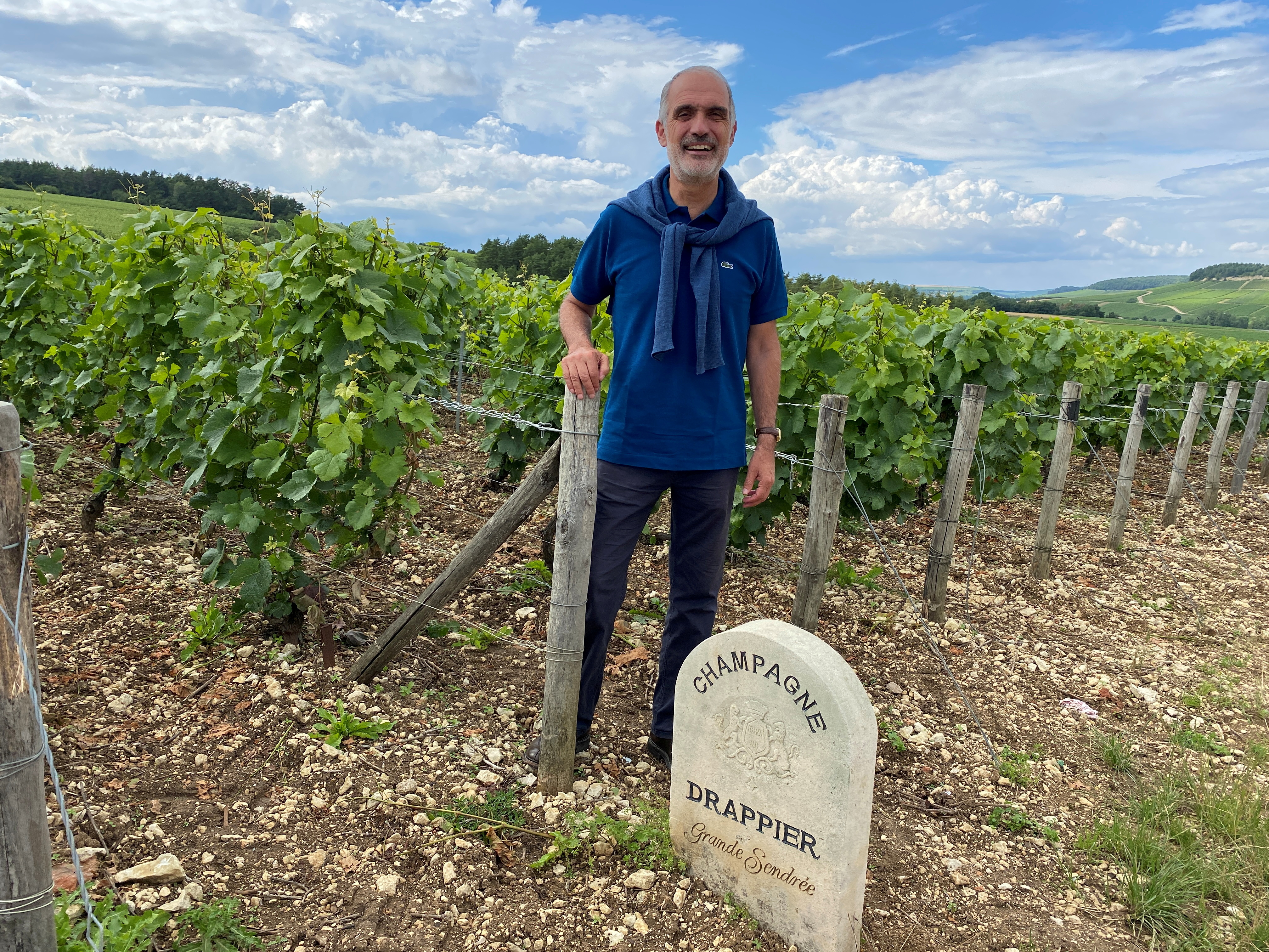 French champagne producer Michel Drappier poses in his vineyard in Urville, France, July 8, 2021, after Russia adopted new law requiring French producers to label their product as