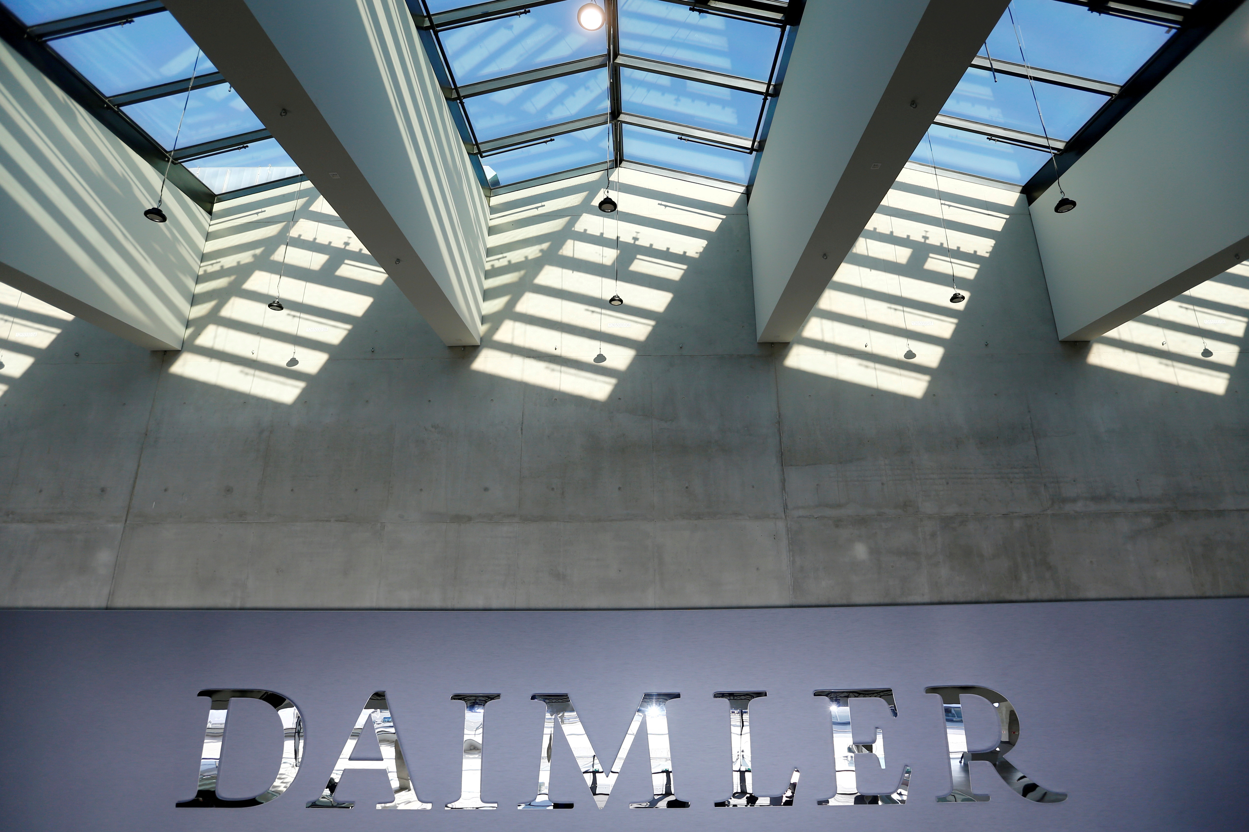 The Daimler logo is seen before the carmaker's annual shareholder meeting in Berlin, Germany, April 5, 2018. REUTERS/Hannibal Hanschke/File Photo
