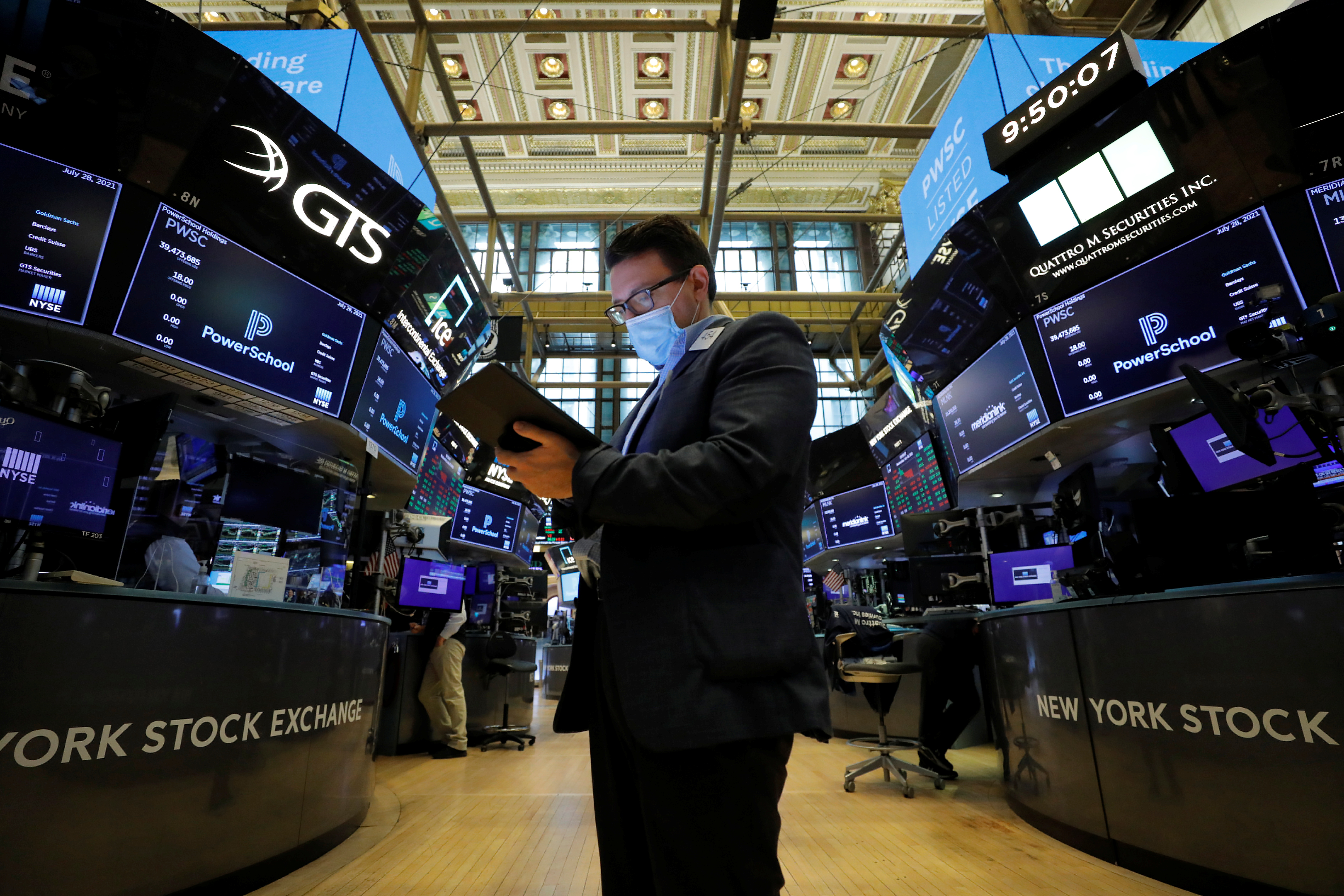 A trader works on the floor of the New York Stock Exchange (NYSE) in New York City, New York, U.S., July 28, 2021. REUTERS/Andrew Kelly