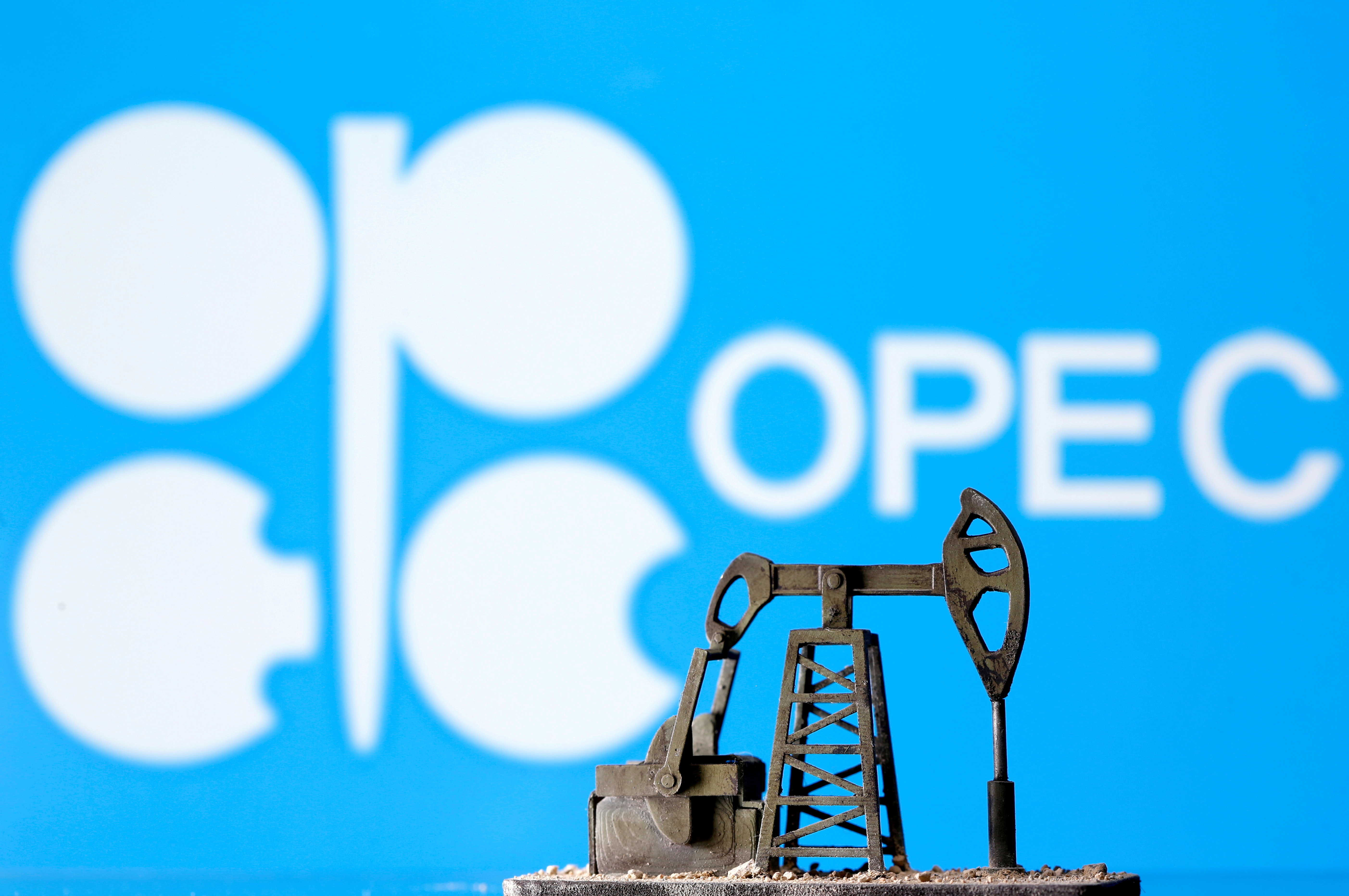 A 3D printed oil pump jack is seen in front of displayed Opec logo in this illustration picture, April 14, 2020. REUTERS/Dado Ruvic/Illustration/File Photo