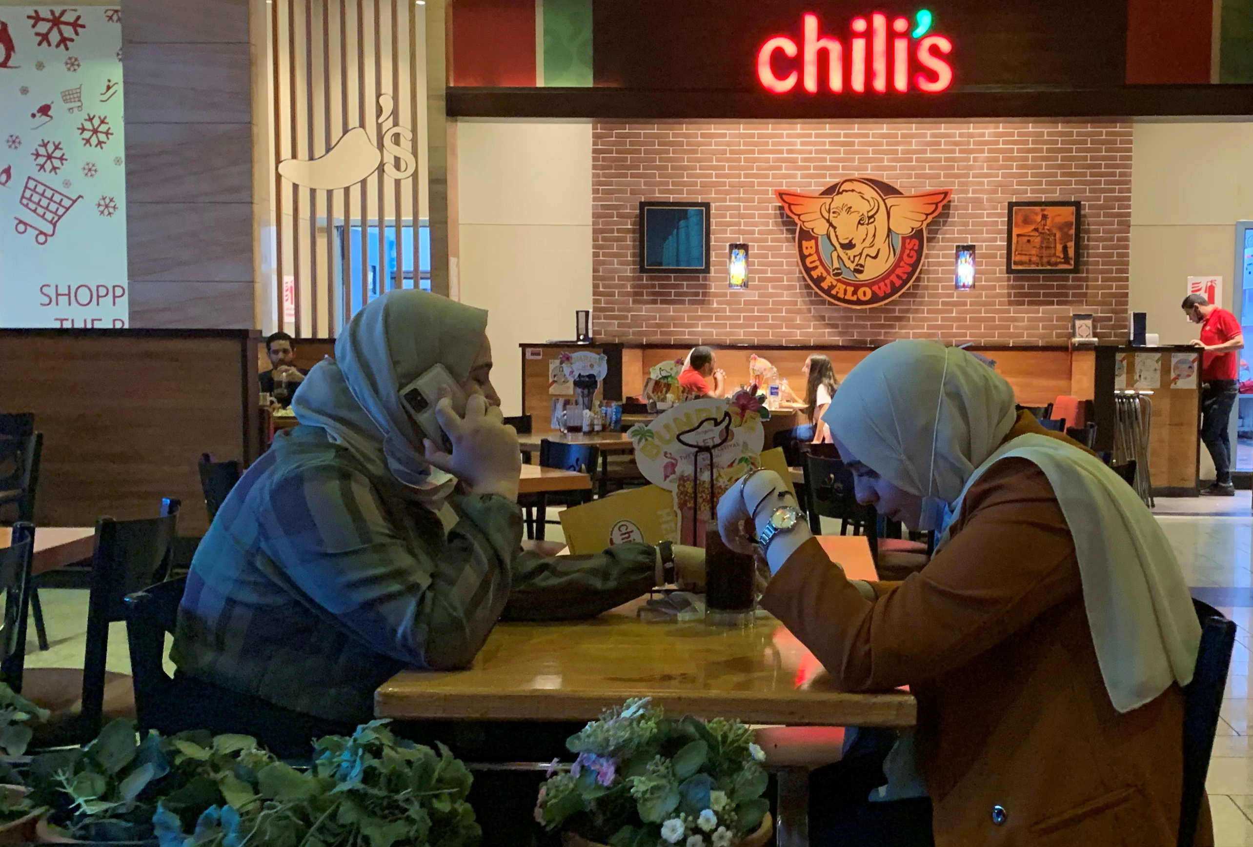 People dine at American restaurant Chili's, amid the coronavirus disease (COVID-19) pandemic at Mall of Egypt, known as