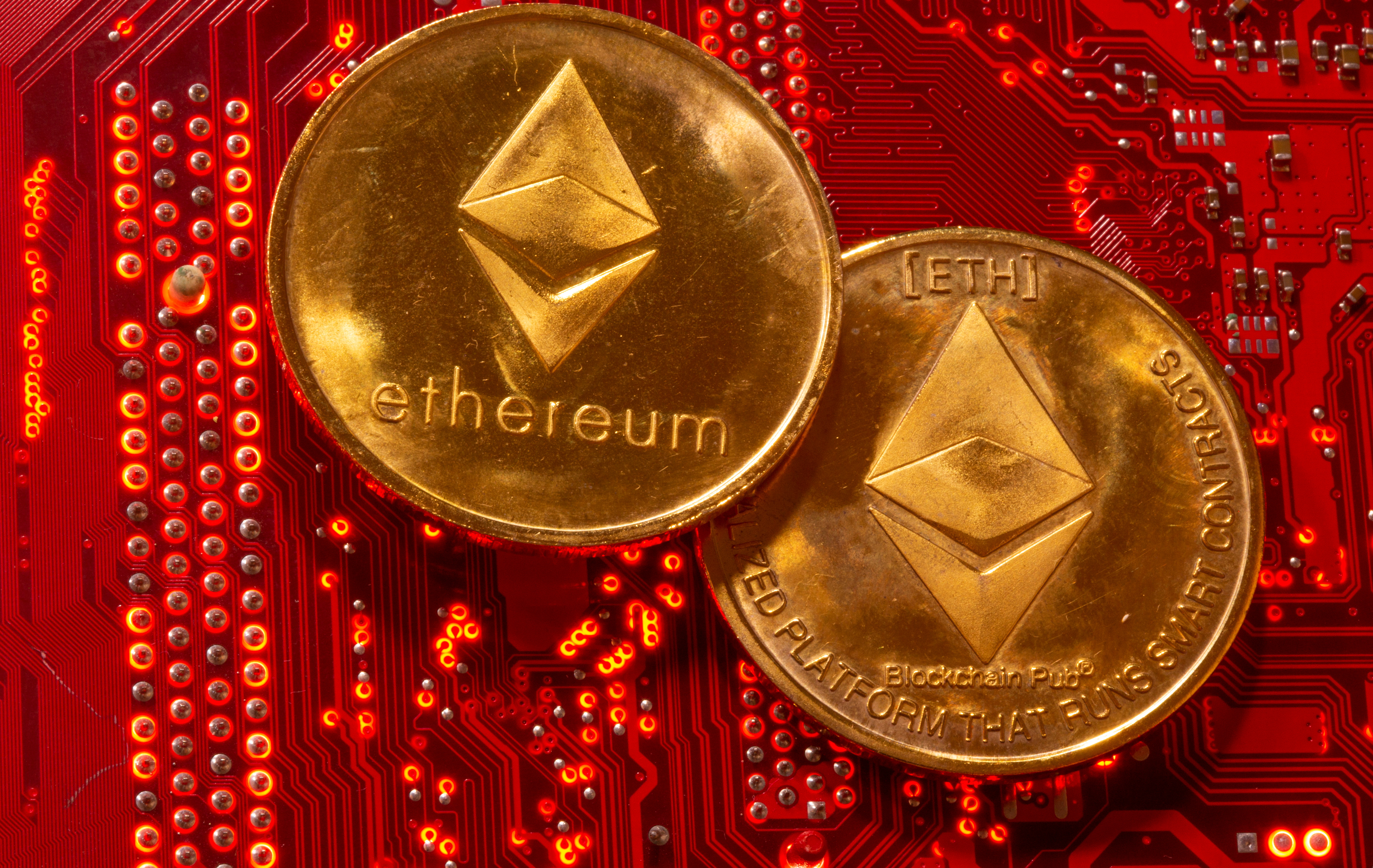 Representations of cryptocurrency Ethereum are placed on PC motherboard in this illustration taken, June 29, 2021. REUTERS/Dado Ruvic/Illustration