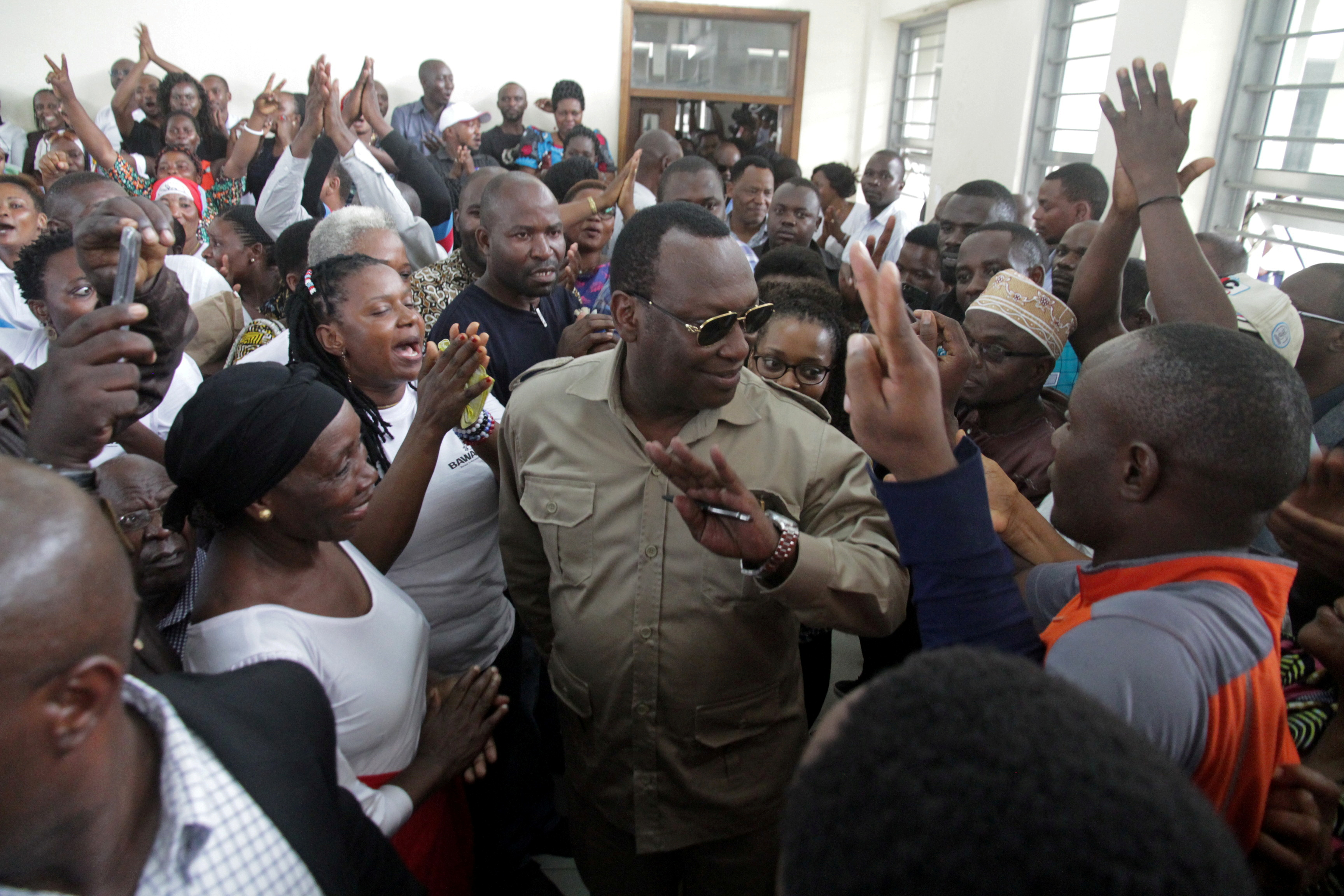 Freeman Mbowe (C), chairman of Chadema, Tanzania's main opposition party, arrives at Kisutu Magistrate Court in Dar es Salaam, Tanzania March 10, 2020. REUTERS/Emmanuel Herman/File Photo