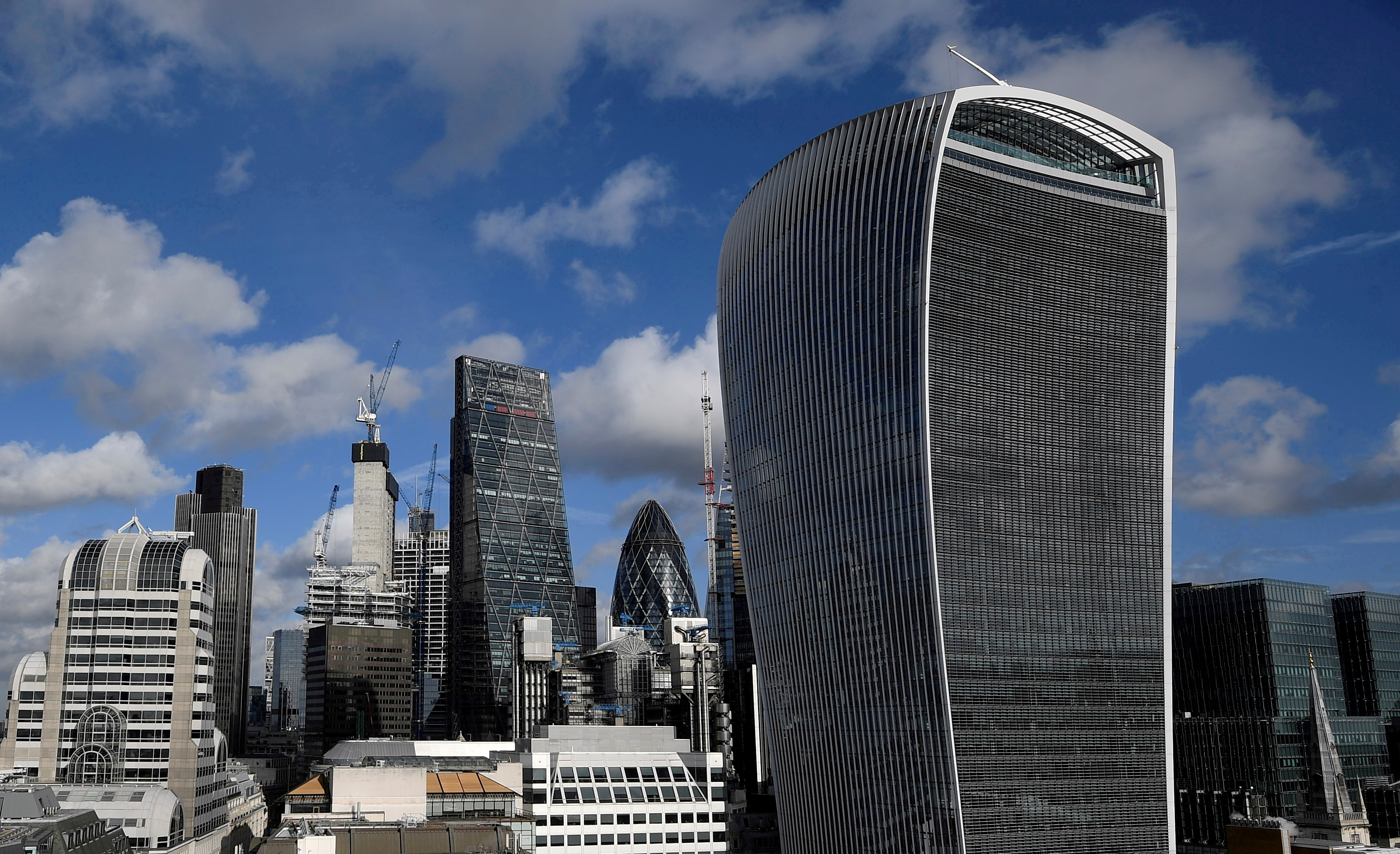 The City of London financial district is seen with office skyscrapers commonly known as 'Cheesegrater', 'Gherkin' and 'Walkie Talkie' seen in London, Britain, January 25, 2018. Picture taken January 25, 2018.  REUTERS/Toby Melville//File Photo