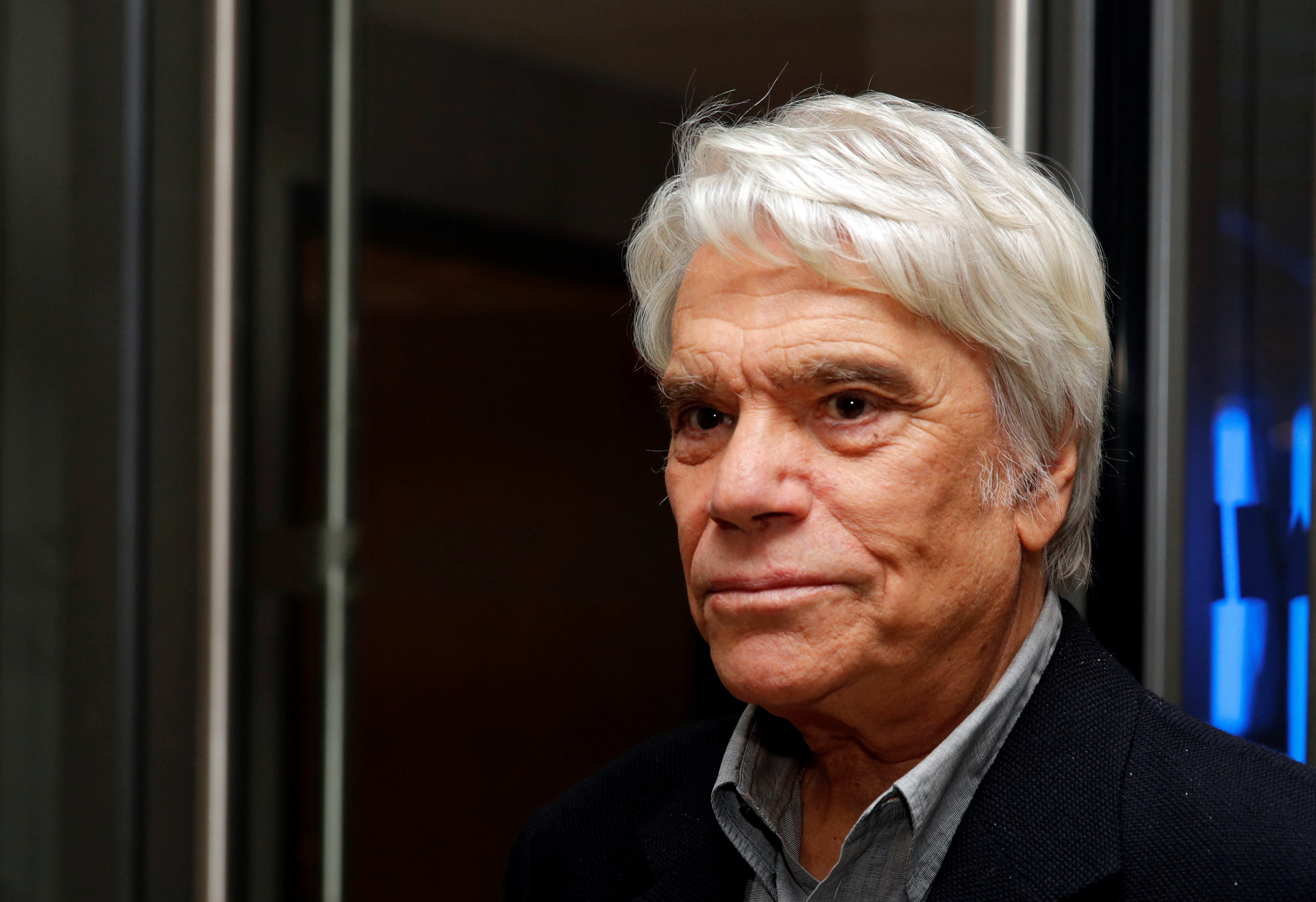 French businessman Bernard Tapie arrives to attend the inauguration of the Altice Campus in Paris in Paris, France, October 9, 2018.  REUTERS/Philippe Wojazer/File Photo