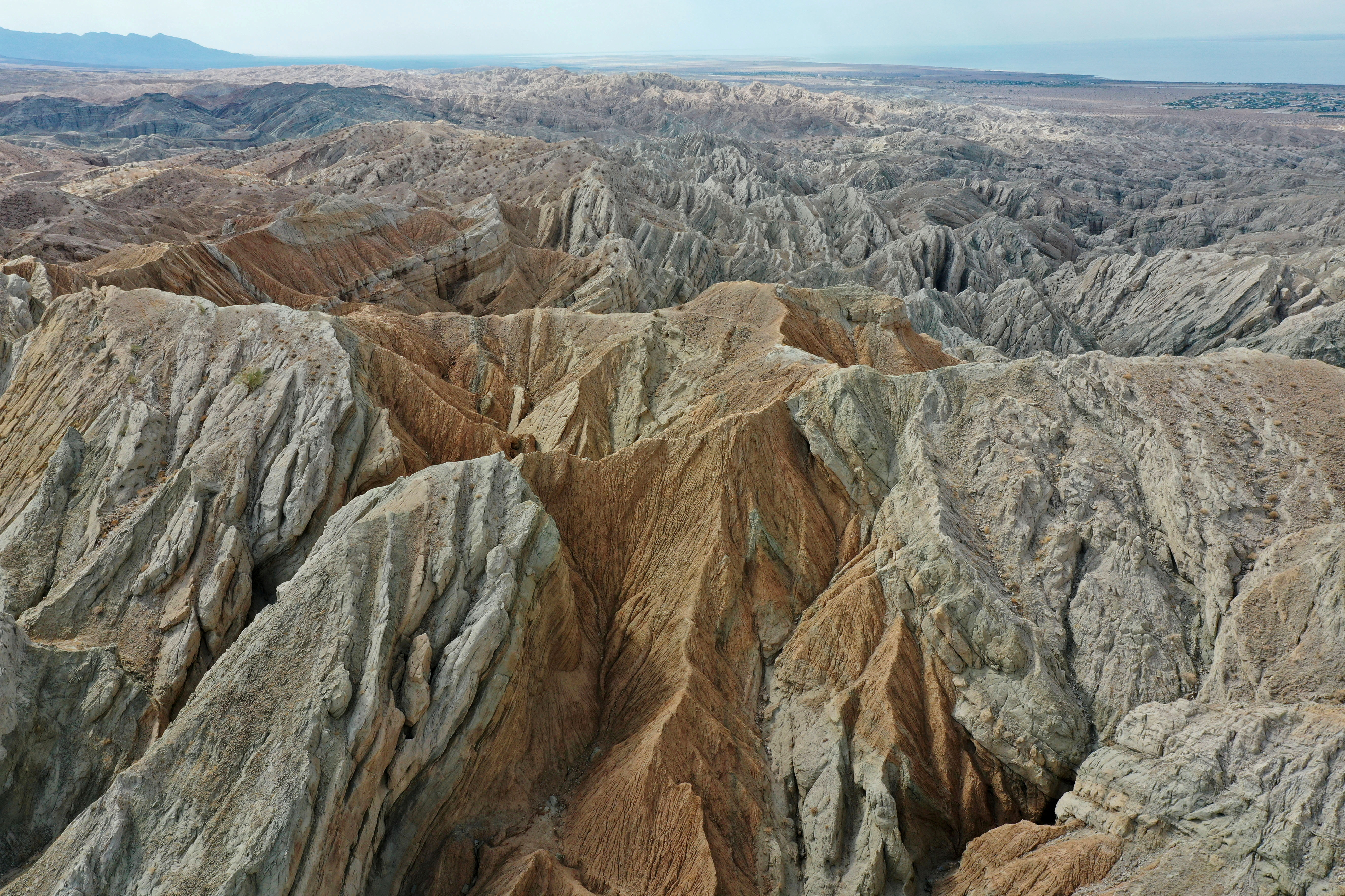 An aerial view shows different rocks and minerals above the San Andreas Faults where the North American Plate and the Pacific Plate collide near the Salton Sea in Mecca, California, U.S., July 4, 2021. REUTERS/Aude Guerrucci