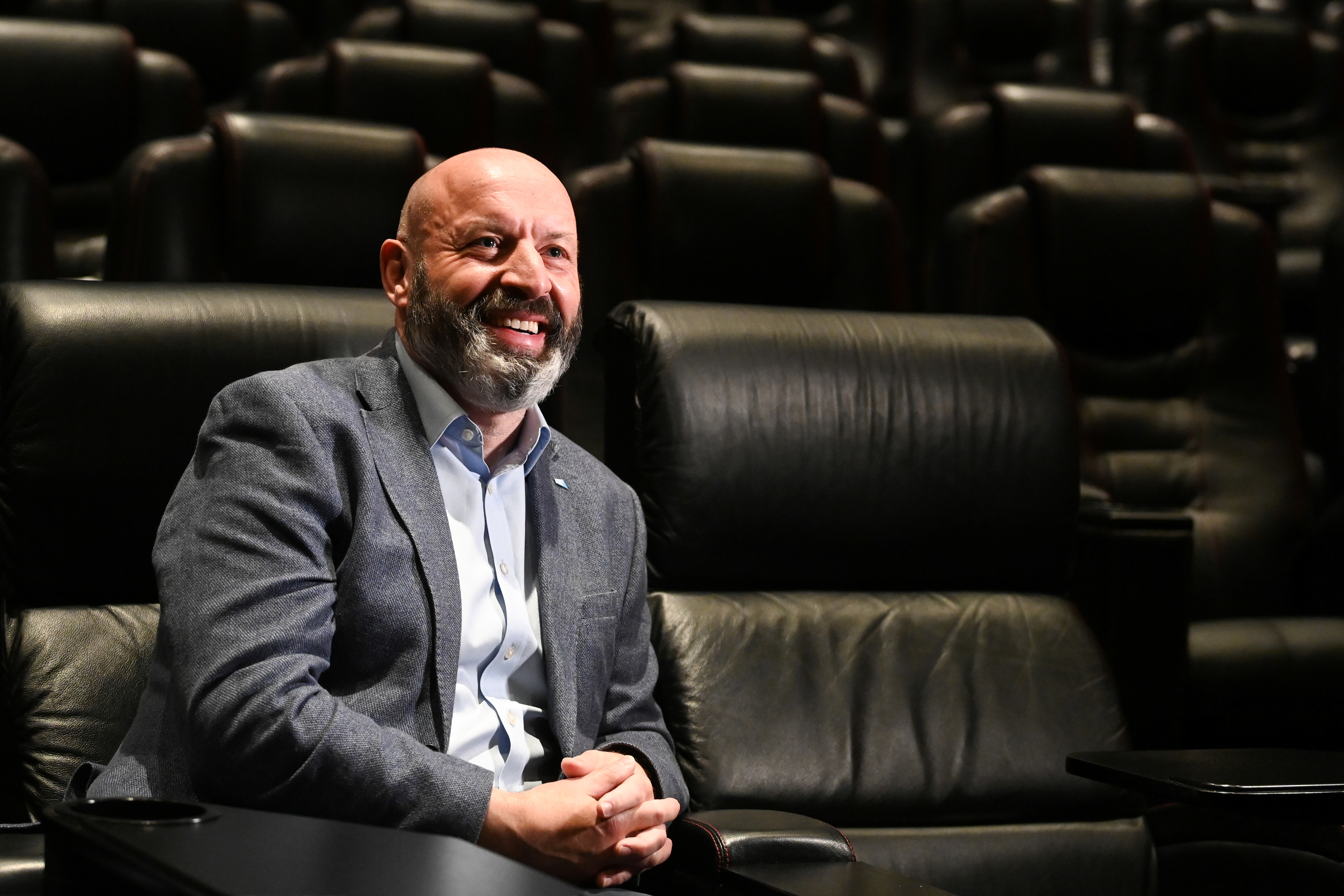 Phil Clapp, Chief Executive of the UK Cinema Association, poses at an auditorium of Vue cinema in Leicester Square during its reopening, as coronavirus disease (COVID-19) restrictions continue to ease, in London, Britain, May 17, 2021. REUTERS/Toby Melville