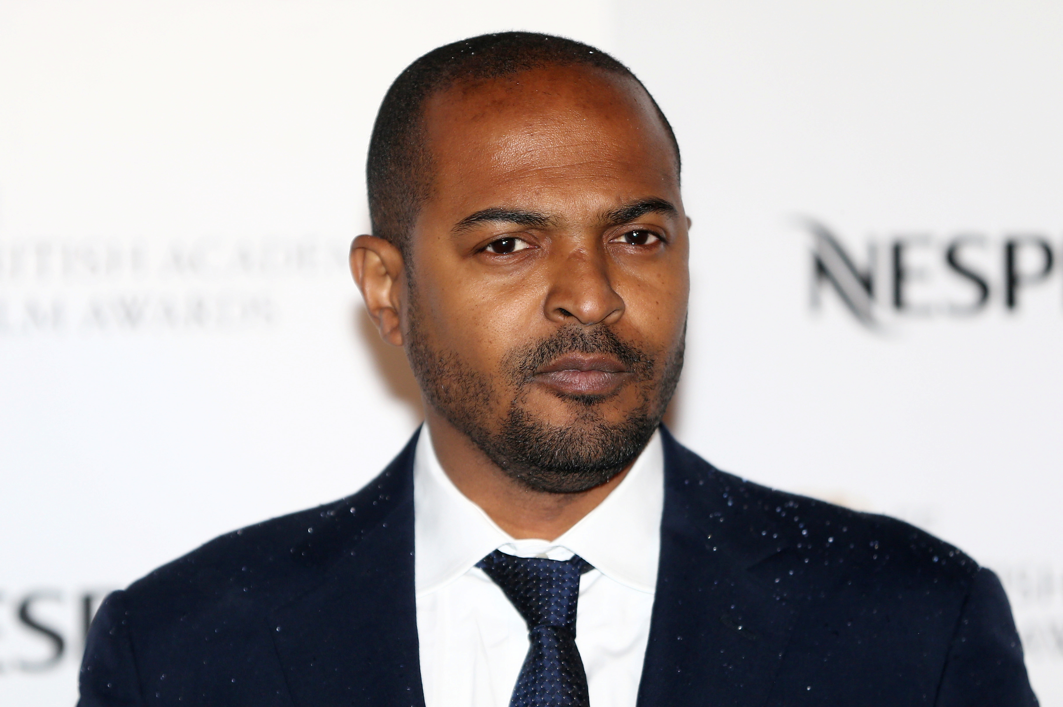 Actor Noel Clarke poses for photographers at the British Academy Film Awards Nominees Party at Kensington Palace in London, Britain February 11, 2017. REUTERS/Neil Hall