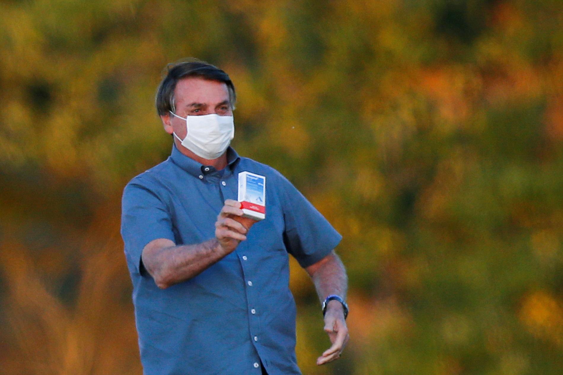 Brazil's President Jair Bolsonaro holds a box of chloroquine outside of the Alvorada Palace, amid the coronavirus disease (COVID-19) outbreak in Brasilia, Brazil, July 23, 2020.REUTERS/Adriano Machado/File photo