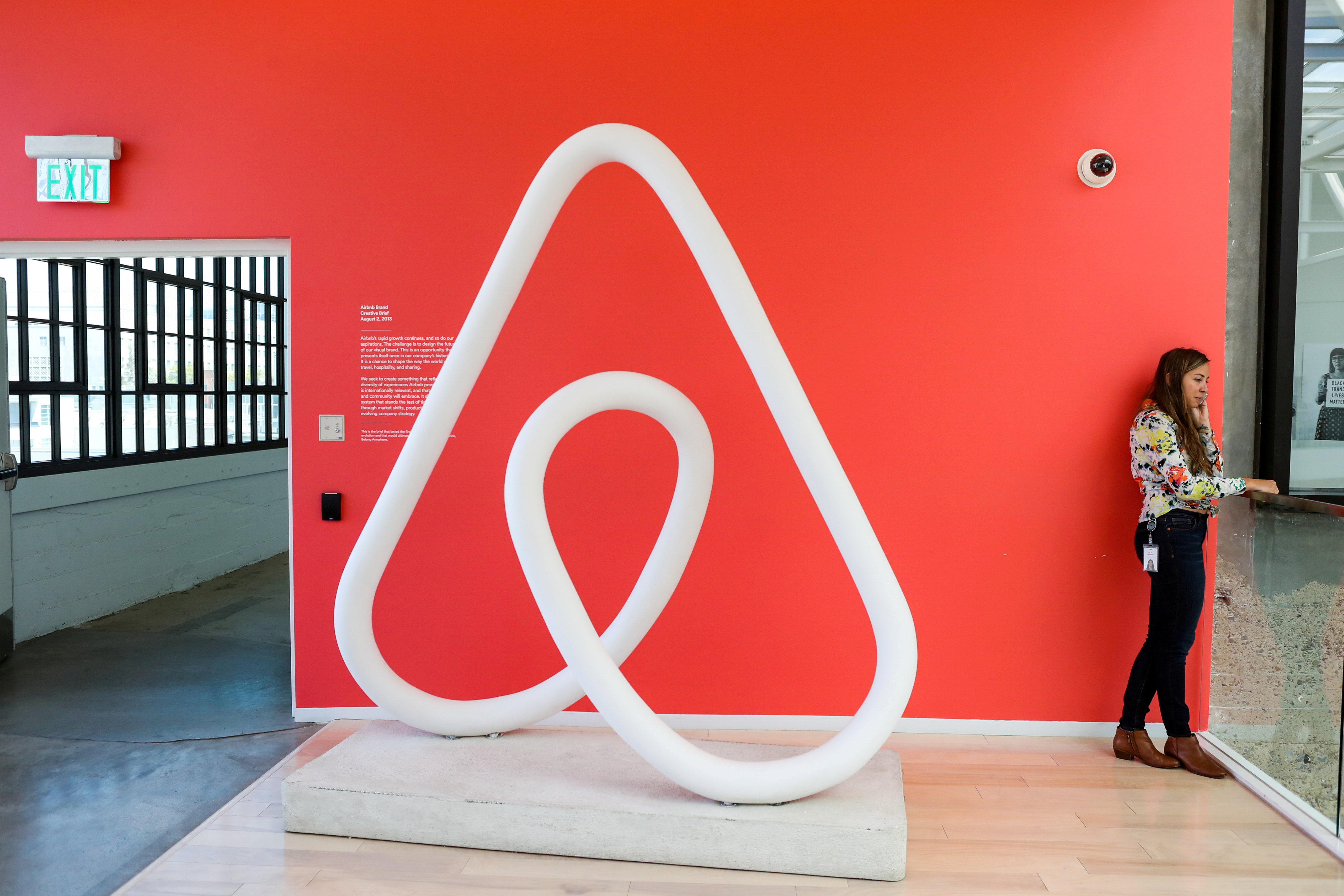 A woman talks on the phone at the Airbnb office headquarters in the SOMA district of San Francisco, California, U.S., August 2, 2016.  REUTERS/Gabrielle Lurie