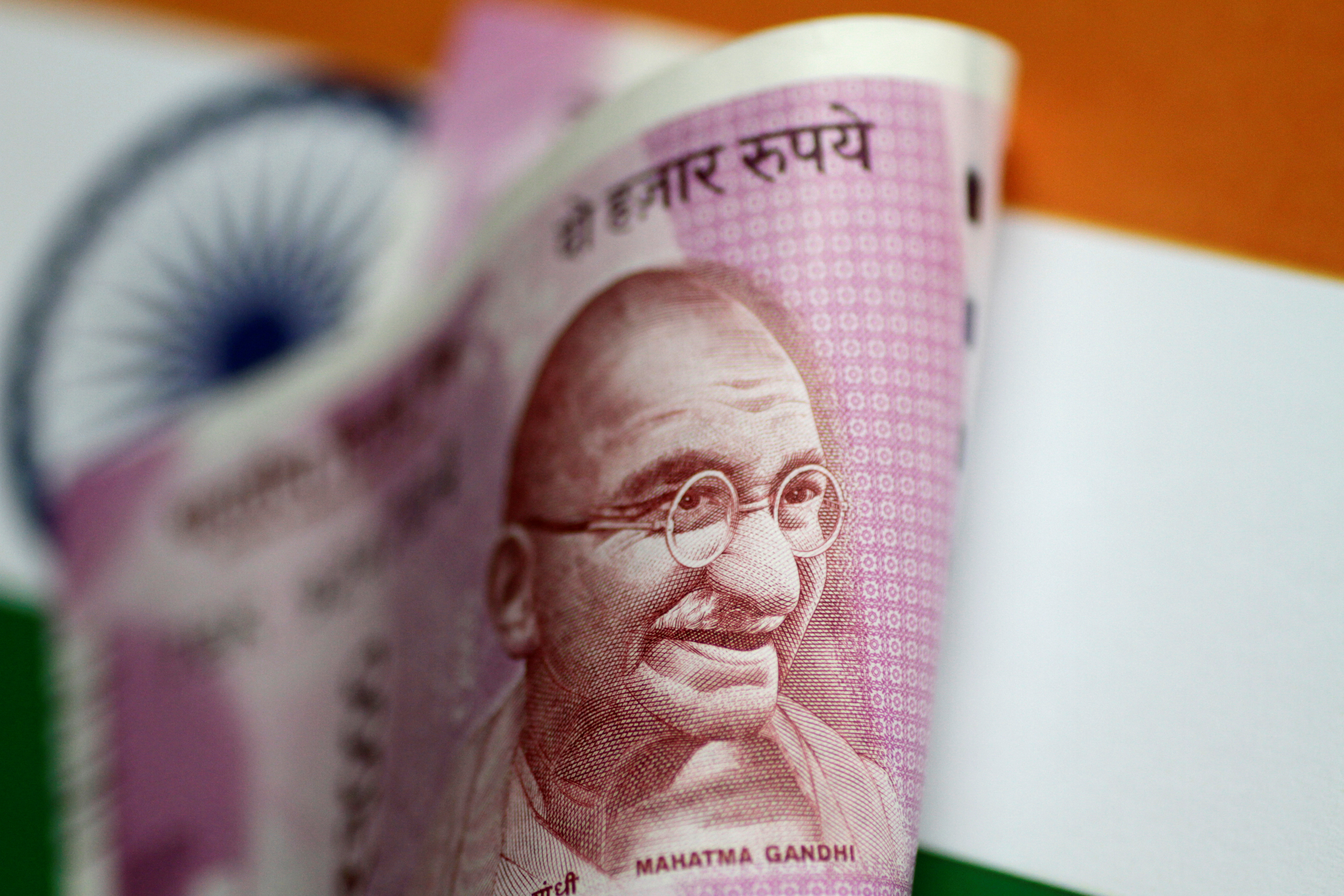 An India Rupee note is seen in this illustration photo June 1, 2017. REUTERS/Thomas White/Illustration/Files