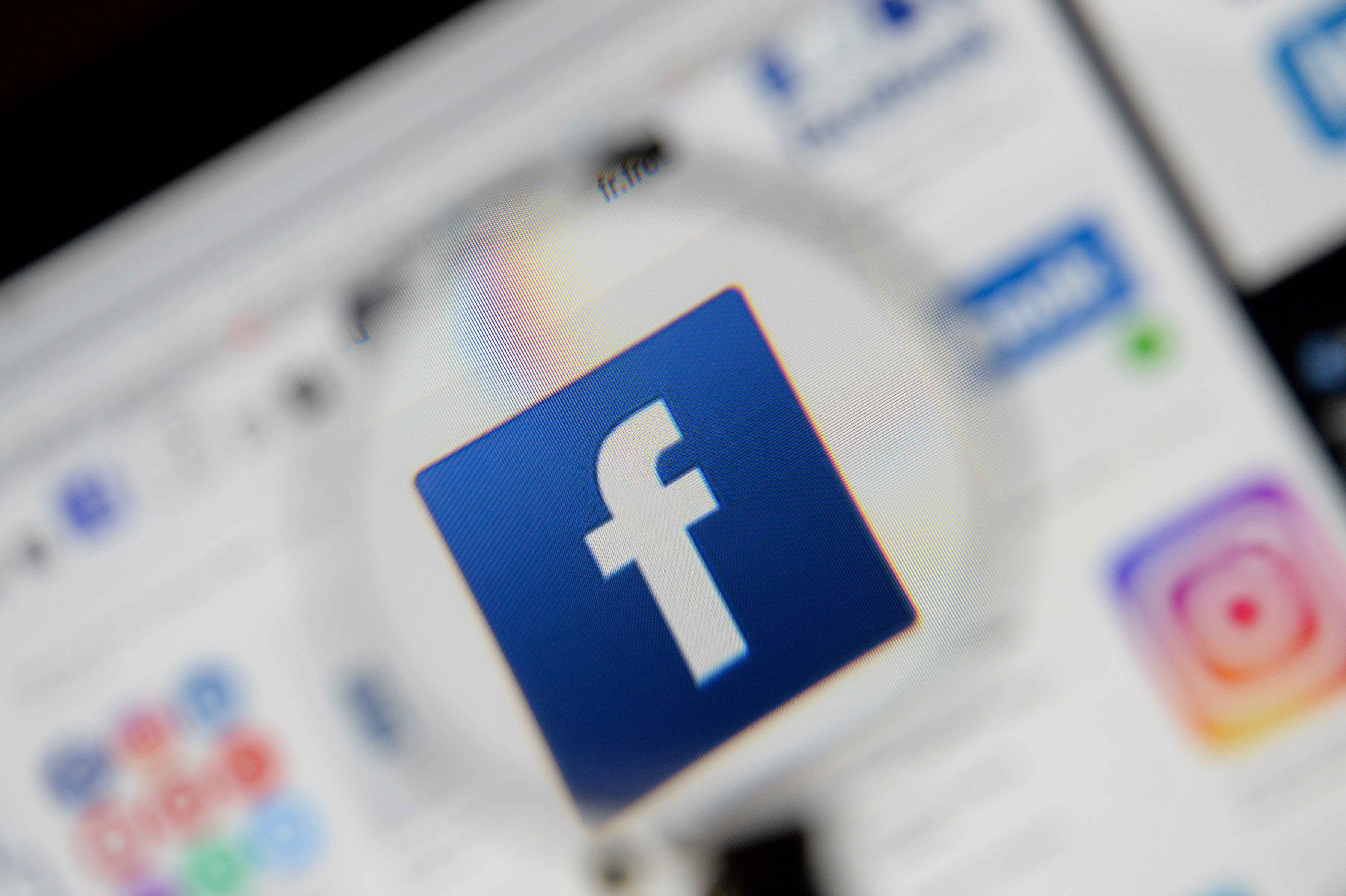 The Facebook logo is seen on a screen in this picture illustration taken December 2, 2019. REUTERS/Johanna Geron/Illustration/File Photo