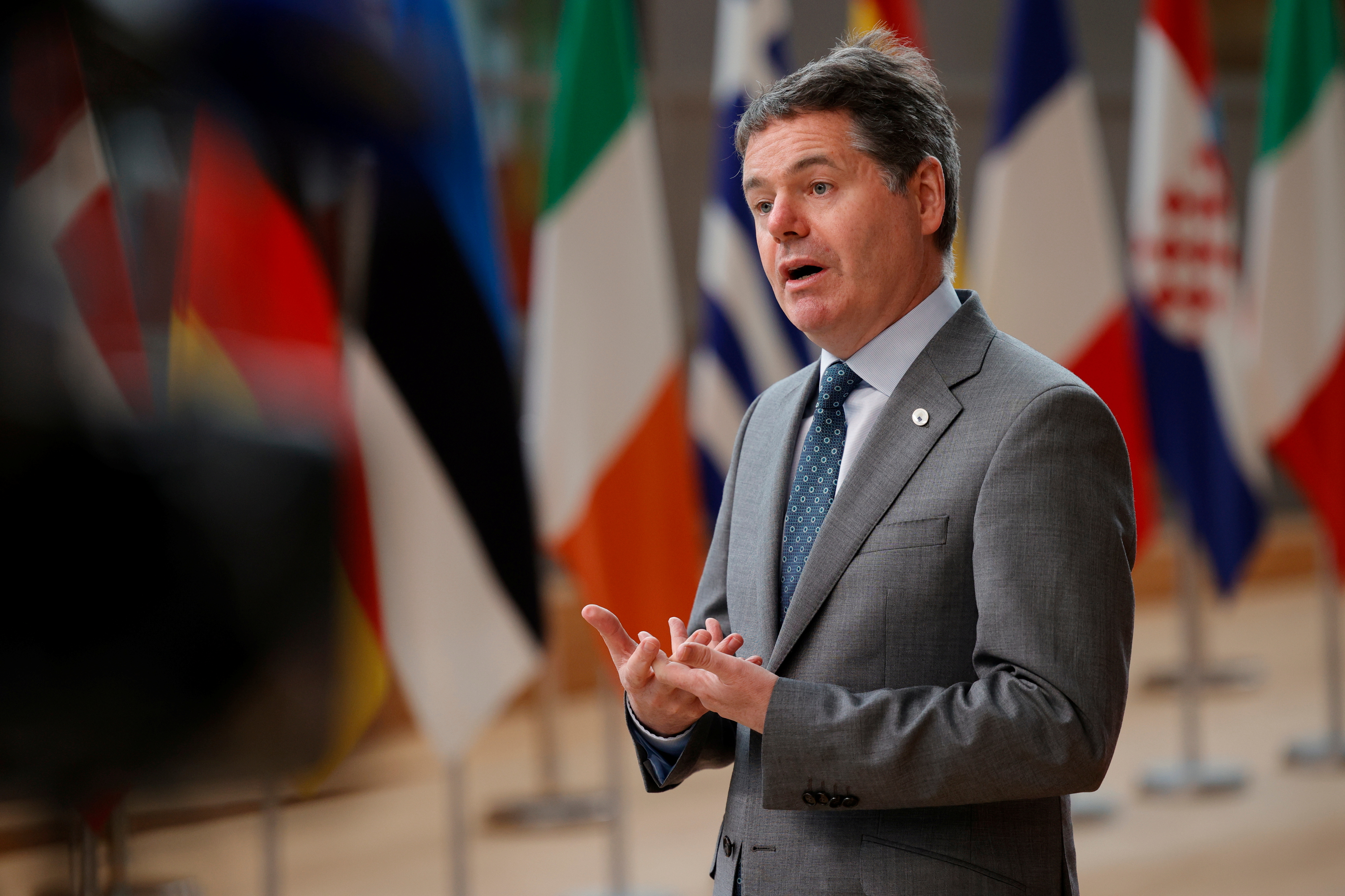 Eurogroup President Paschal Donohoe talks to journalists as he arrives for the second day of a EU summit at the European Council building in Brussels, Belgium June 25, 2021. Olivier Matthys/Pool via REUTERS