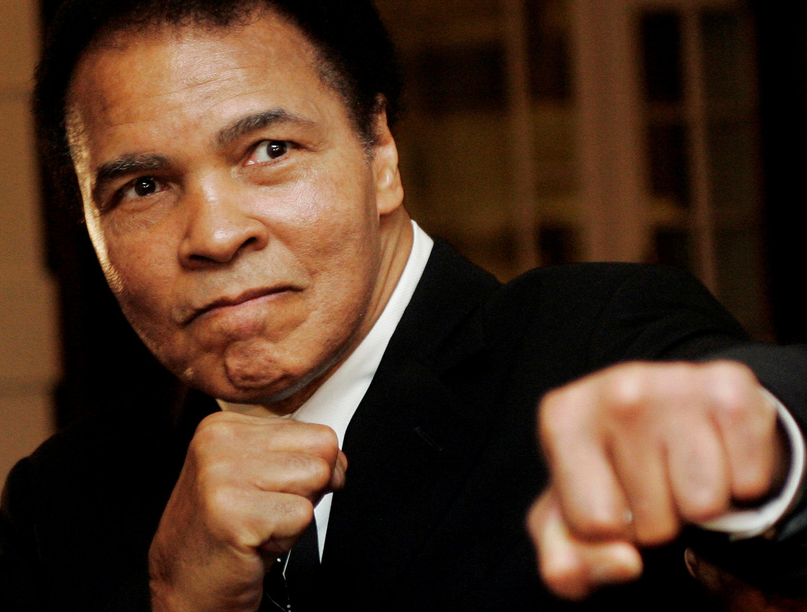 U.S. boxing great Muhammad Ali poses during the Crystal Award ceremony at the World Economic Forum (WEF) in Davos, Switzerland, in this January 28, 2006 photo. REUTERS/Andreas Meier/File Photo