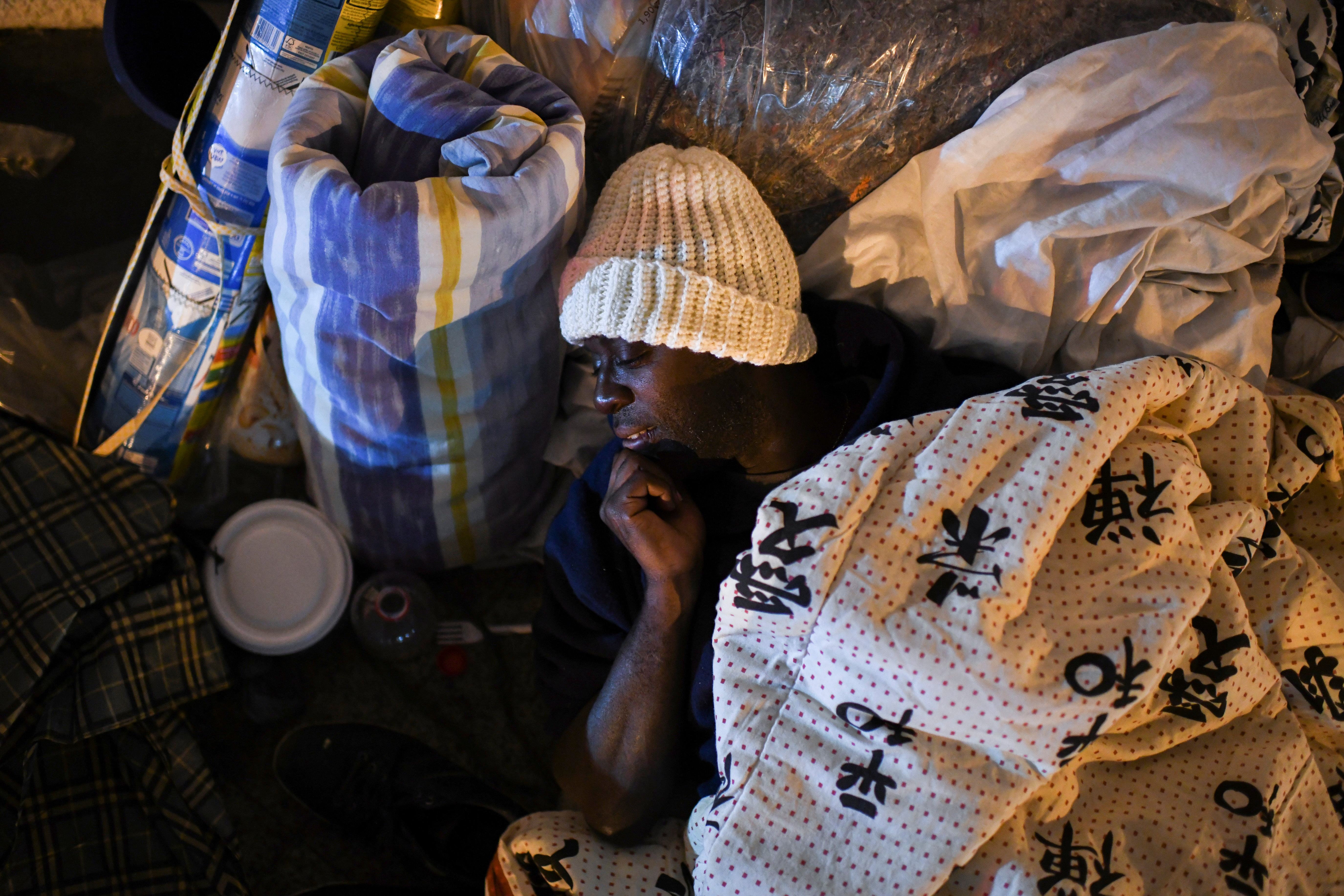 Marcus Vinicius, 27, a homeless man, is pictured as NGO doAcao distributes food and blankets to the homeless while an unusual cold hits Rio de Janeiro, Brazil, July 29, 2021.  REUTERS/Lucas Landau