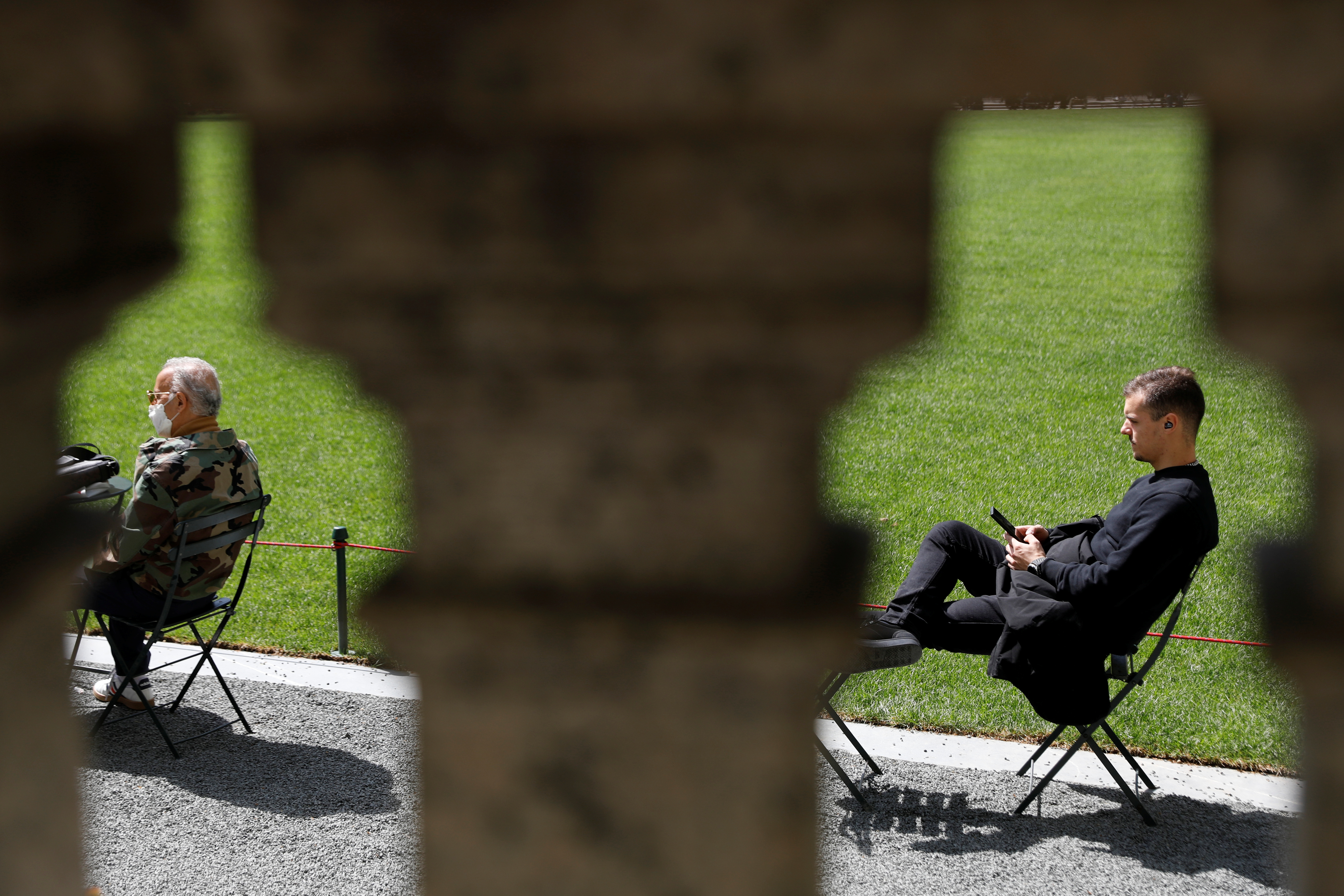 People sit in Bryant Park after the Centers for Disease Control and Prevention (CDC) announced new guidelines regarding outdoor mask wearing and vaccination during the outbreak of the coronavirus disease (COVID-19) in Manhattan, New York City, New York, U.S., April 27, 2021. REUTERS/Andrew Kelly