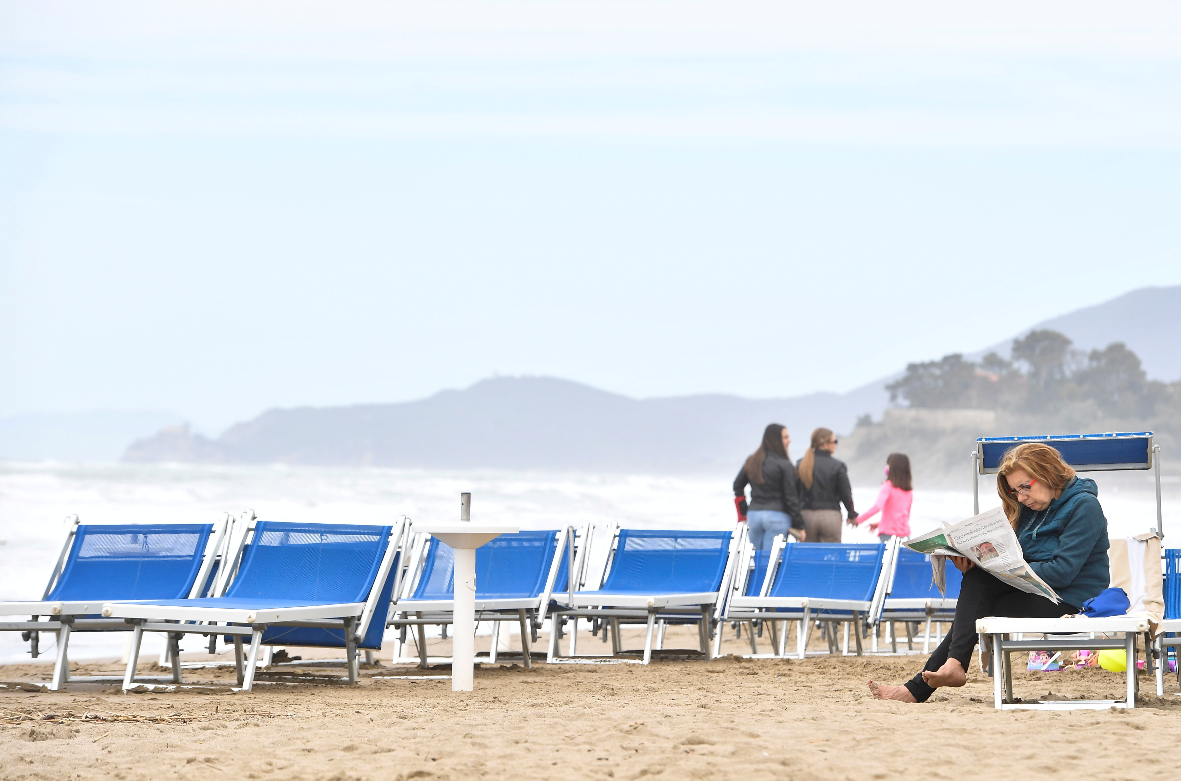 People enjoy a Sunday at the beach as coronavirus disease (COVID-19) restrictions ease around the country, in Castiglione della Pescaia, Italy, May 2, 2021. REUTERS/Jennifer Lorenzini