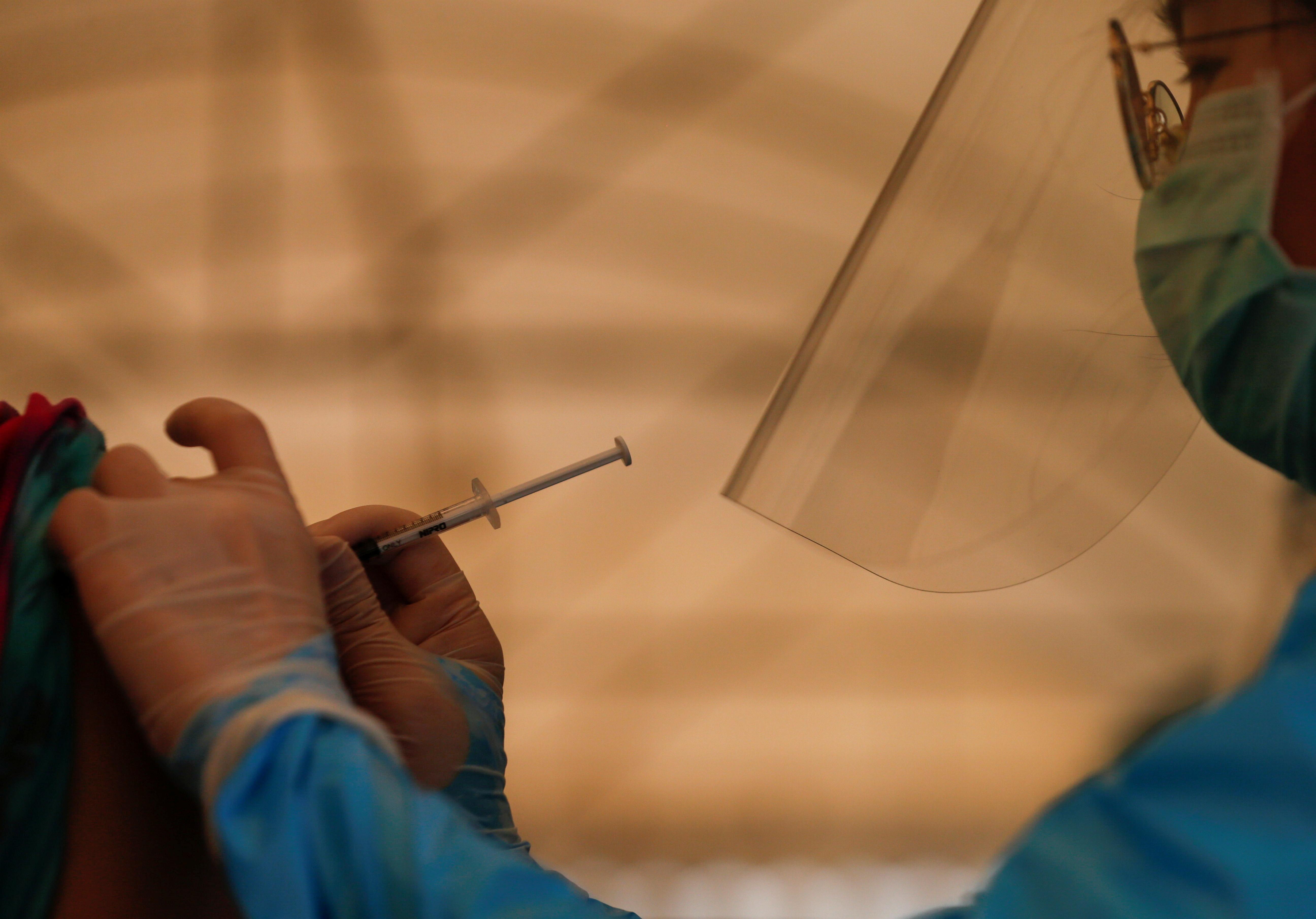 A person from Klong Toey community receives a coronavirus disease (COVID-19) vaccine in Bangkok, Thailand, May 4, 2021. REUTERS/Soe Zeya Tun