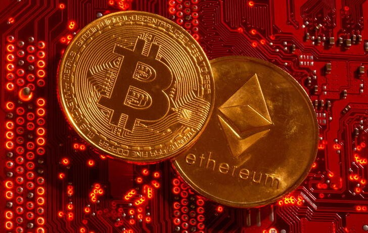 Representations of cryptocurrencies Bitcoin and Ethereum are placed on PC motherboard in this illustration taken, June 29, 2021. REUTERS/Dado Ruvic/Illustration