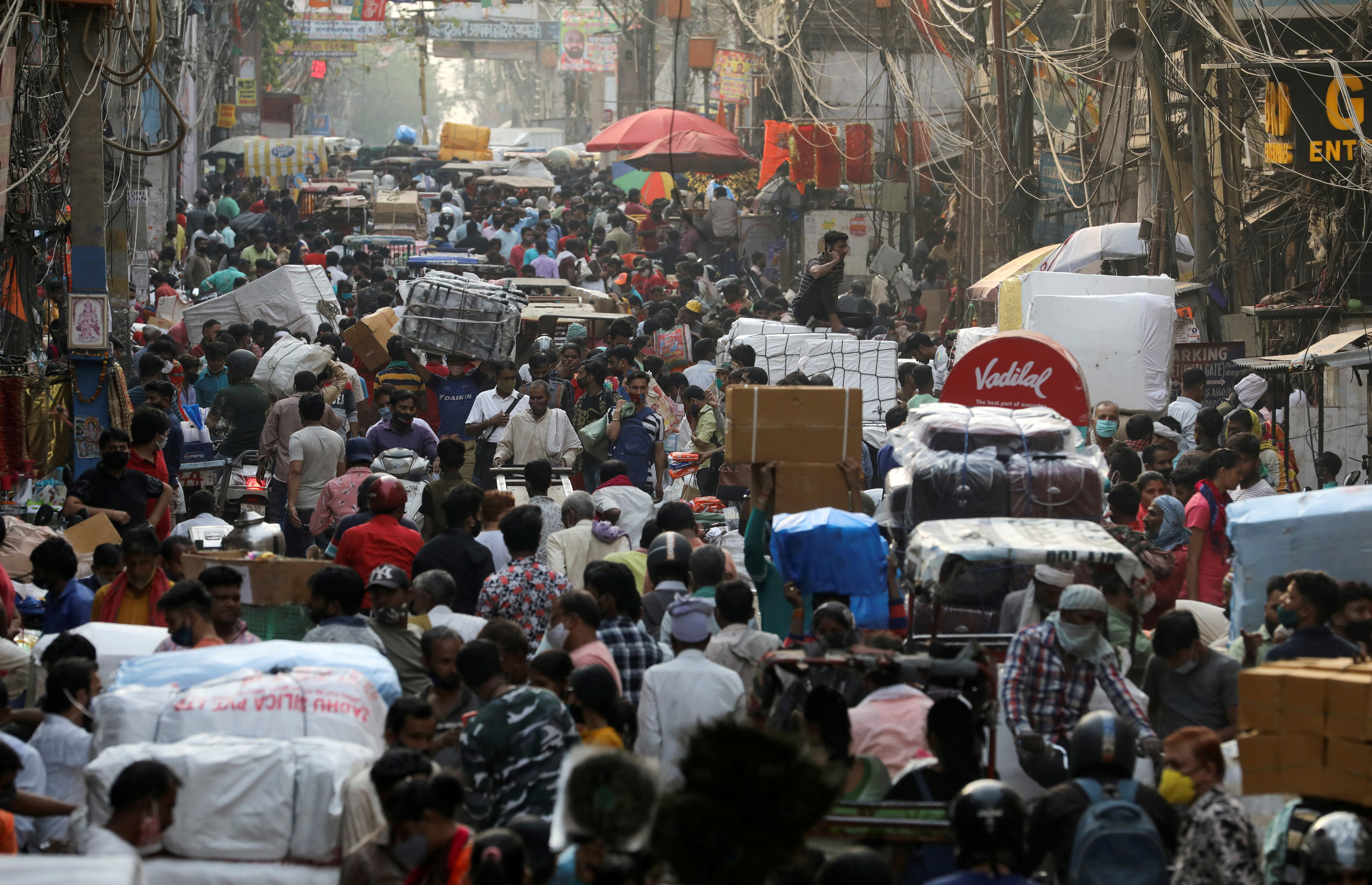 People walk at a crowded market amidst the spread of the coronavirus disease (COVID-19), in the old quarters of Delhi, India, April 6, 2021. REUTERS/Anushree Fadnavis/File Photo