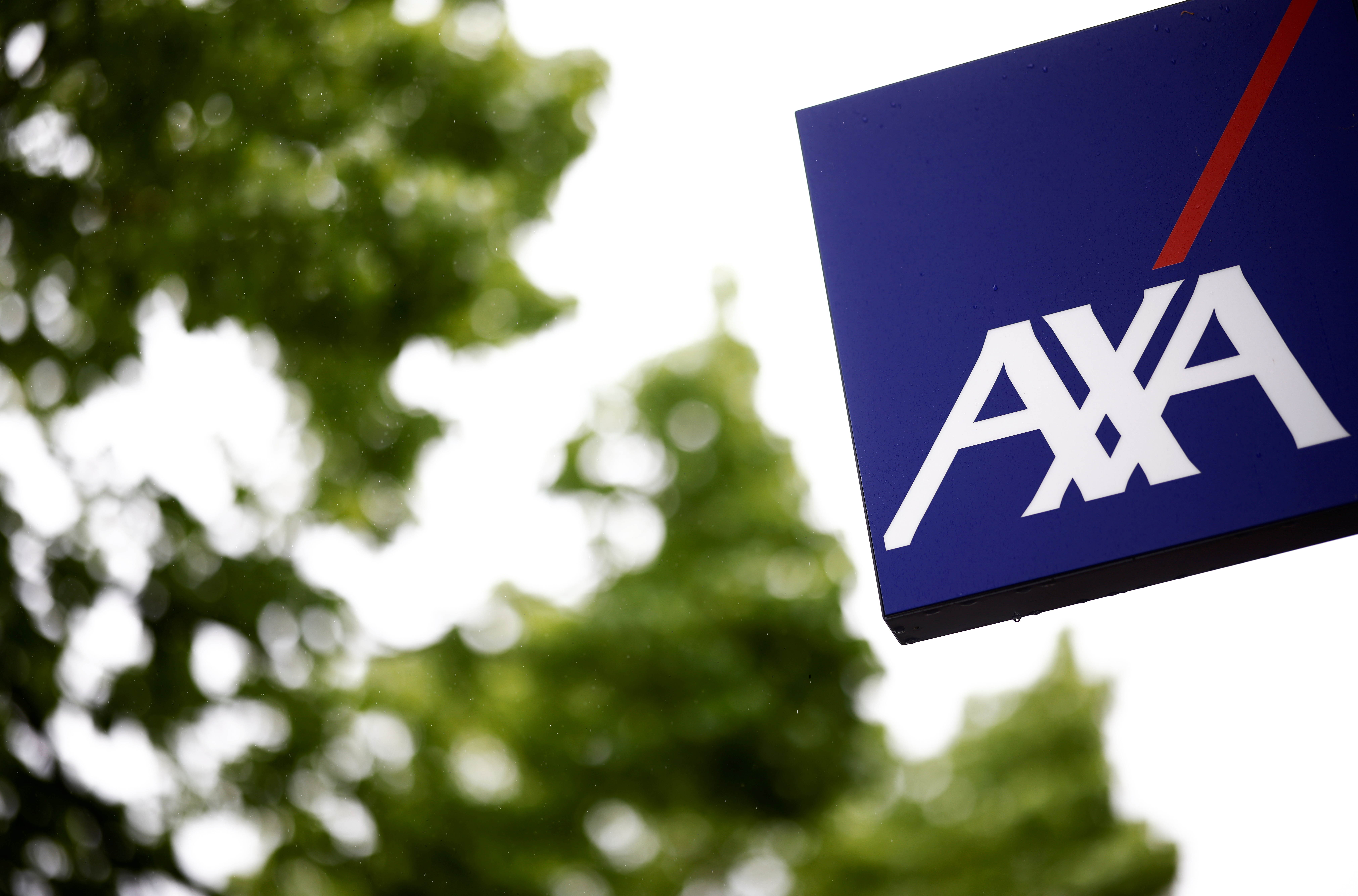 The logo of French Insurer Axa is seen outside a building in Les Sorinieres near Nantes, France, May 4, 2021. REUTERS/Stephane Mahe