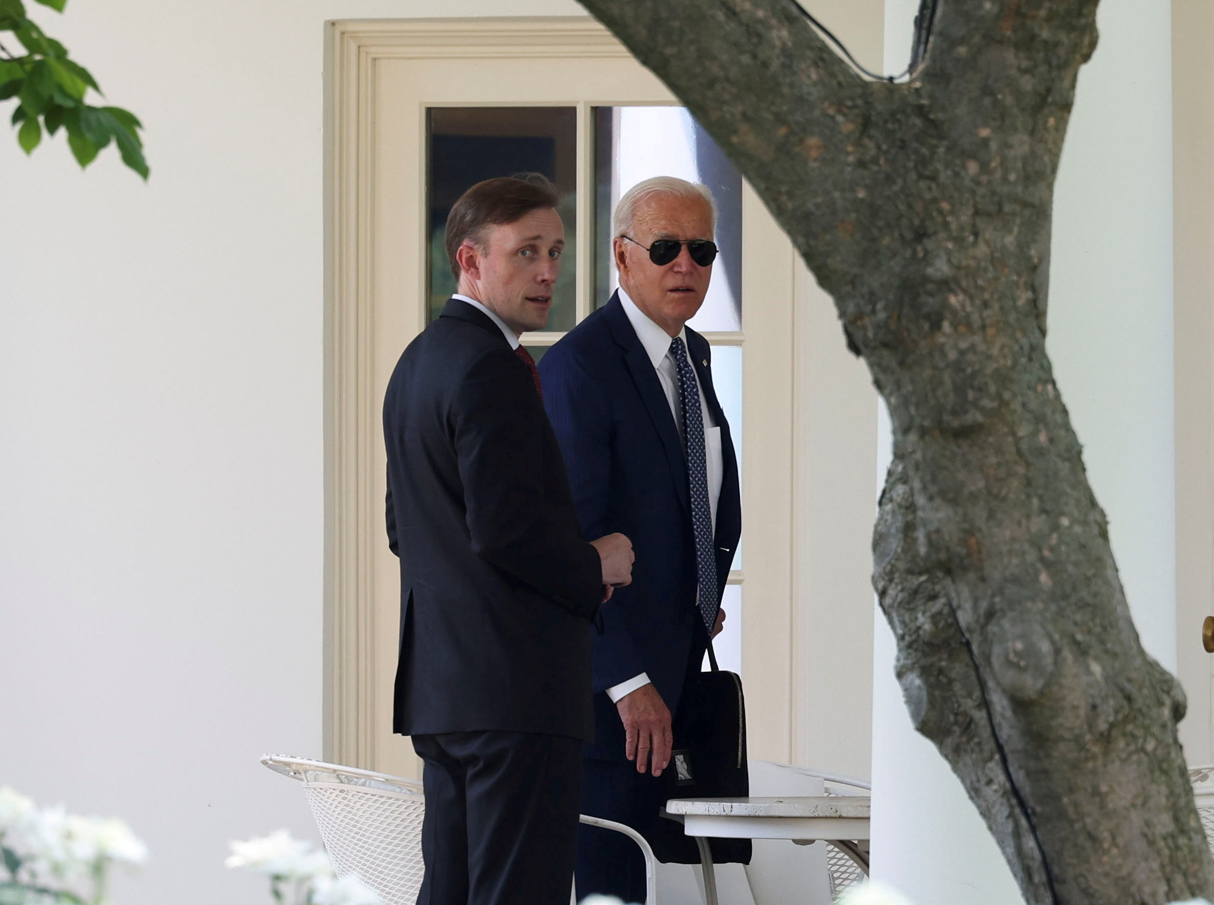 National Security adviser Jake Sullivan accompanies U.S. President Joe Biden following a visit to the Office of the Director of National Intelligence as they they return to the White House Washington, U.S., July 27, 2021. REUTERS/Stringer File Photo