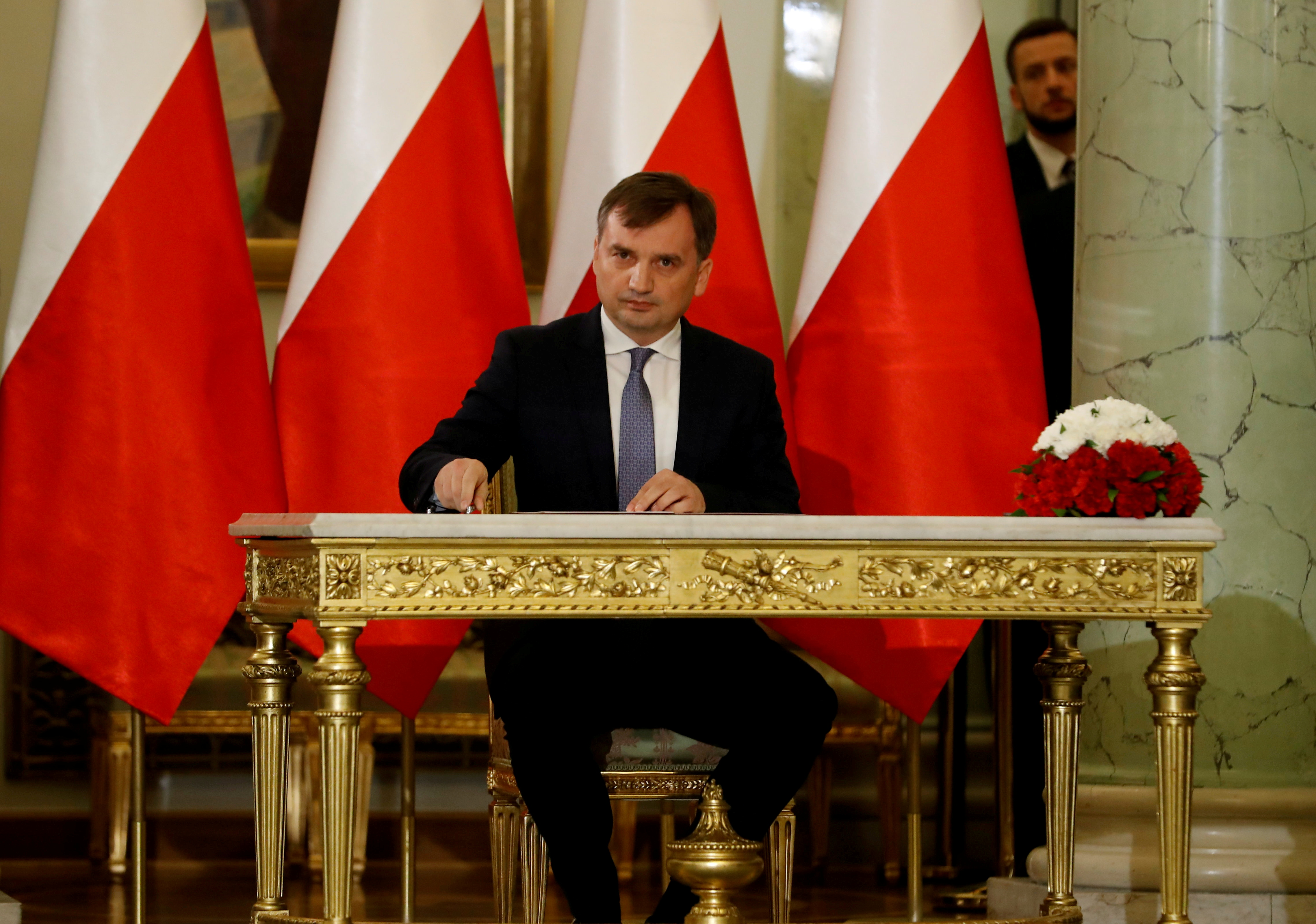 Zbigniew Ziobro signs documents after being designated as Minister of Justice, at the Presidential Palace in Warsaw, Poland November 15, 2019. REUTERS/Kacper Pempel/File Photo