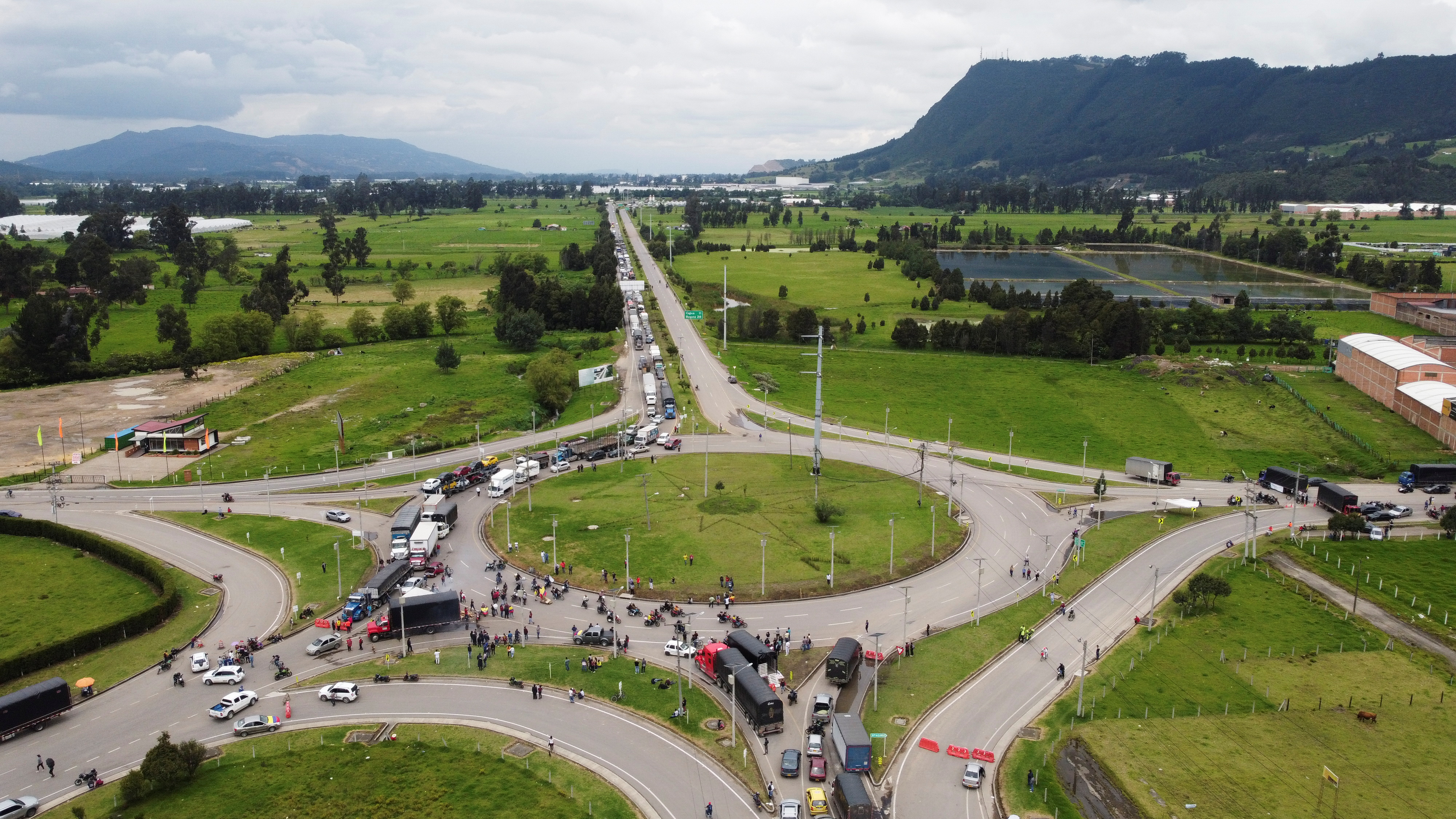 Trucks are seen blocking a road during a protest against the tax reform of President Ivan Duque's government in Zipaquira, Colombia May 3, 2021.  REUTERS/Herbert Villarraga