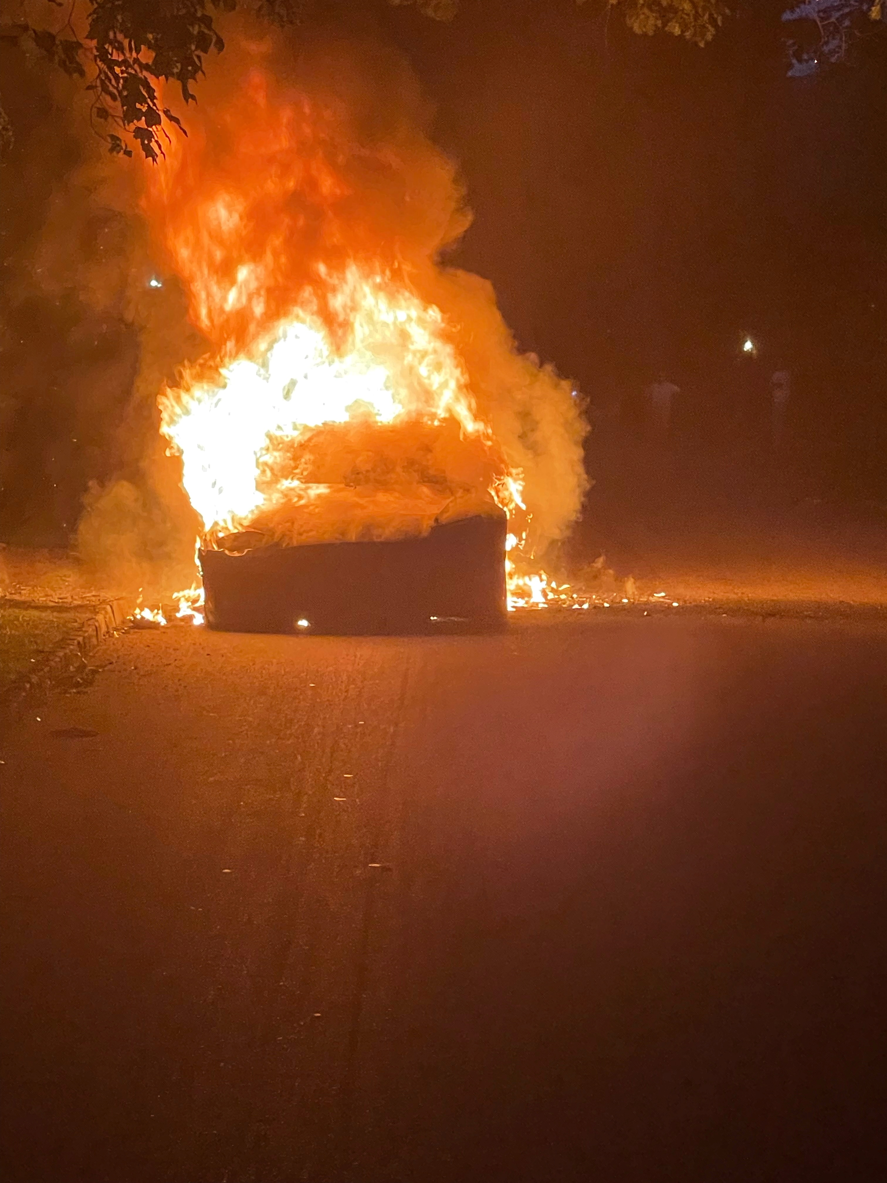 Tesla Inc's new Model S Plaid electric car is seen in flames in Pennsylvania, U.S., in this handout photo provided to Reuters on July 2, 2021. Handout via REUTERS