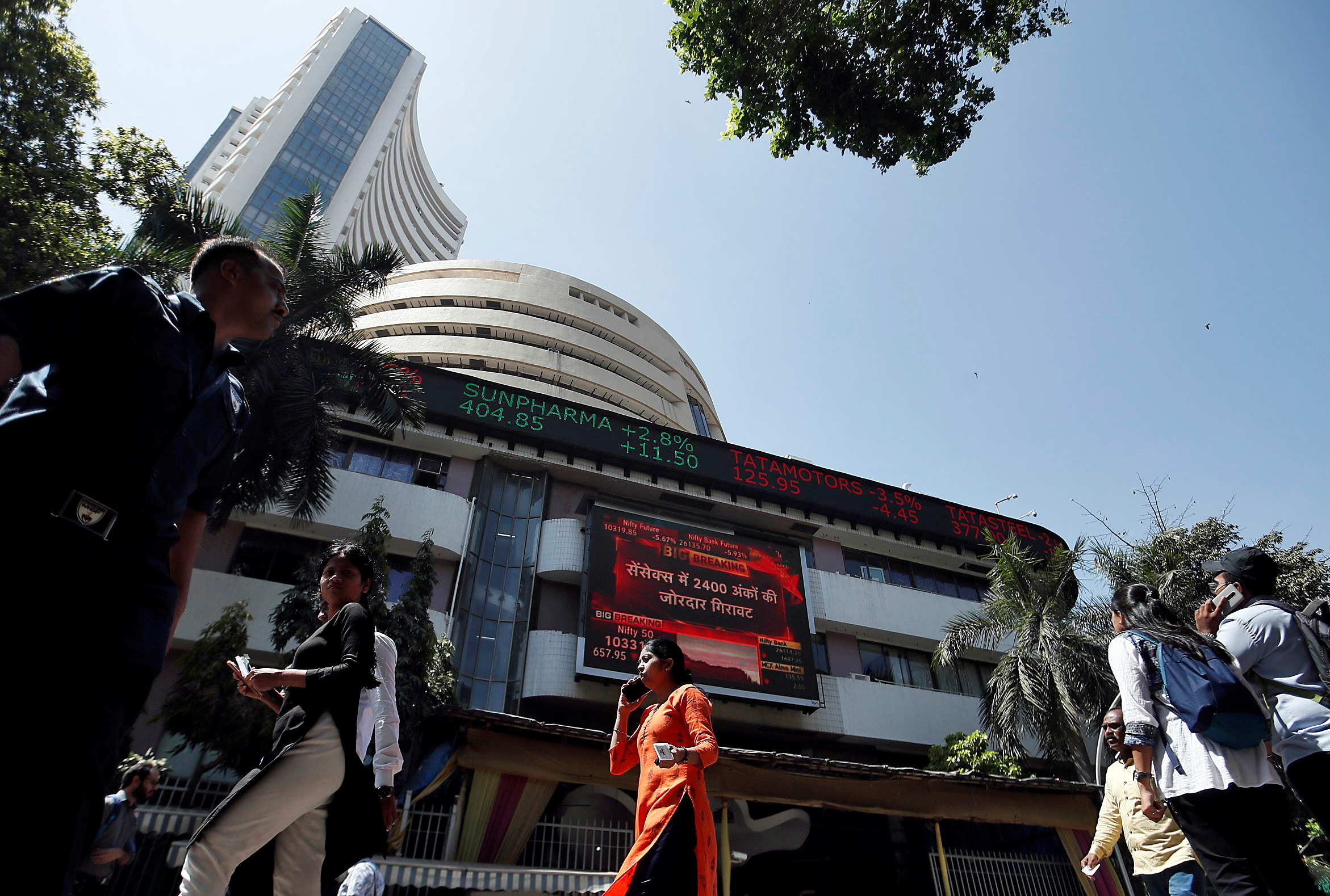 People walk past the Bombay Stock Exchange (BSE) building in Mumbai, India, March 9, 2020. REUTERS/Francis Mascarenhas/File photo
