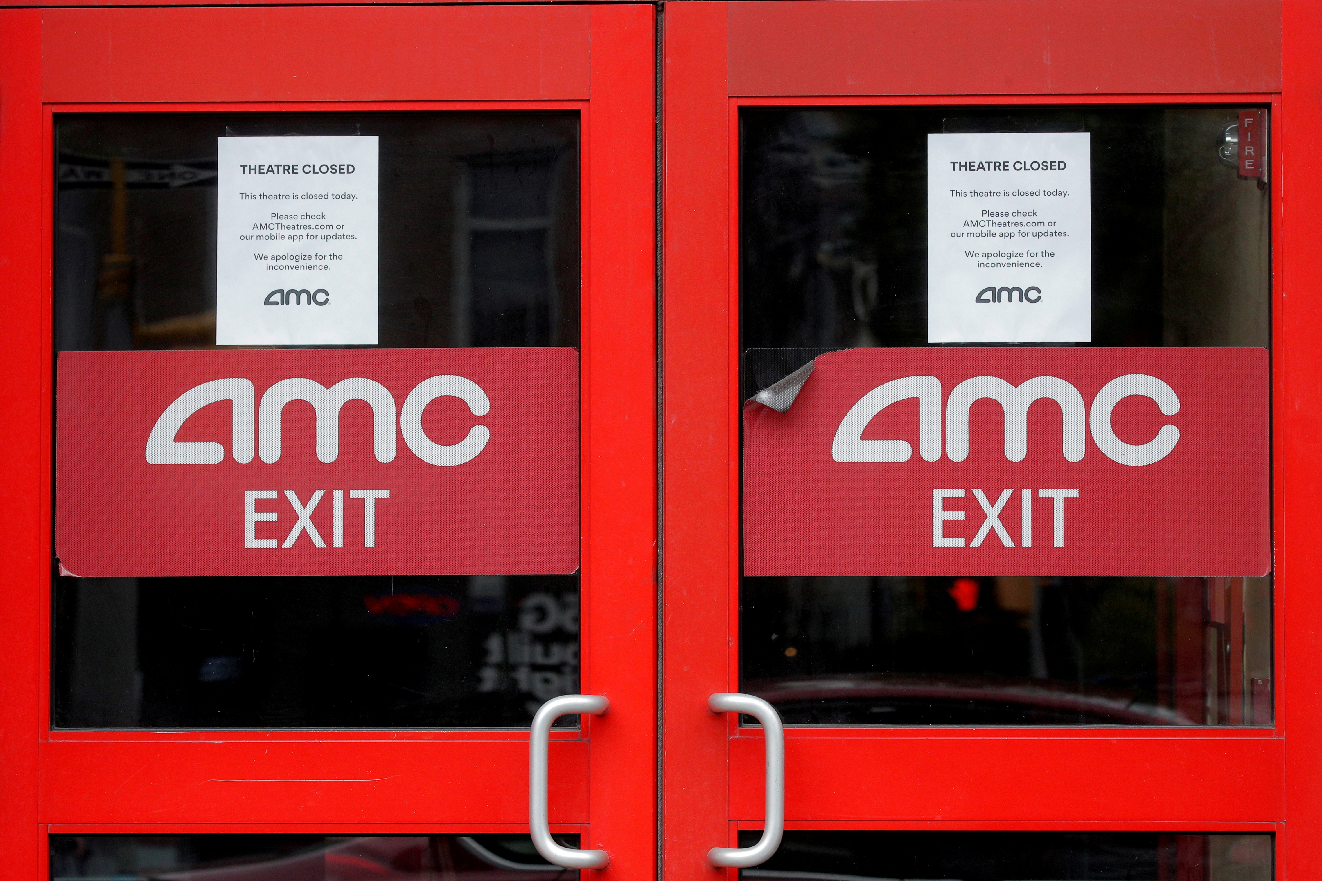 Closed signs are seen on an AMC Theatre during the outbreak of the coronavirus disease (COVID-19), in New York City, U.S., April 29, 2020. REUTERS/Brendan McDermid/File Photo