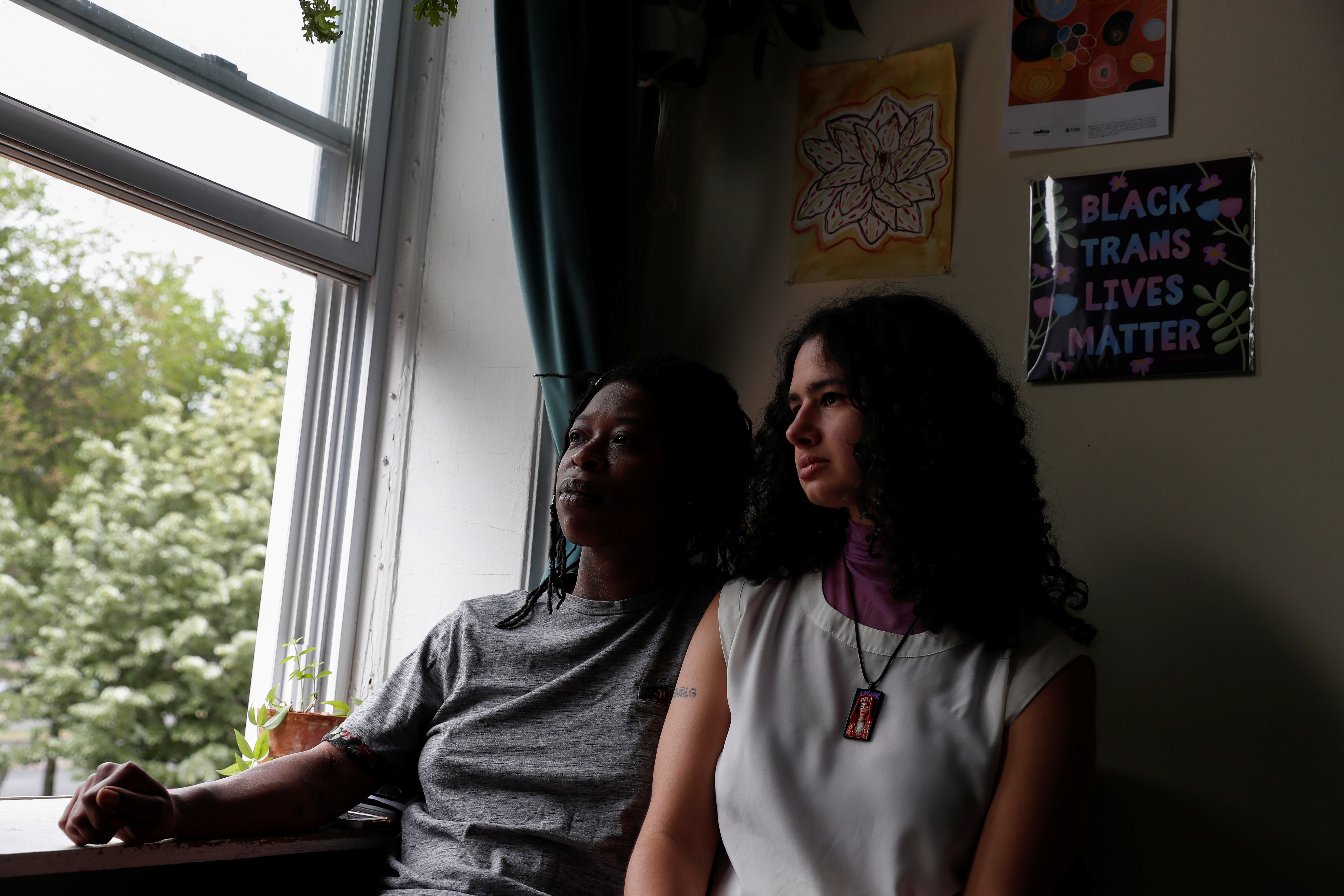 Elsa Eli Waithe and Ada Reso, 'Slavers of New York' campaign co-founders, pose by the window in the Bedford-Stuyvesant section of the Brooklyn borough of New York City, U.S., May 24, 2021. Picture taken May 24, 2021. REUTERS/Shannon Stapleton